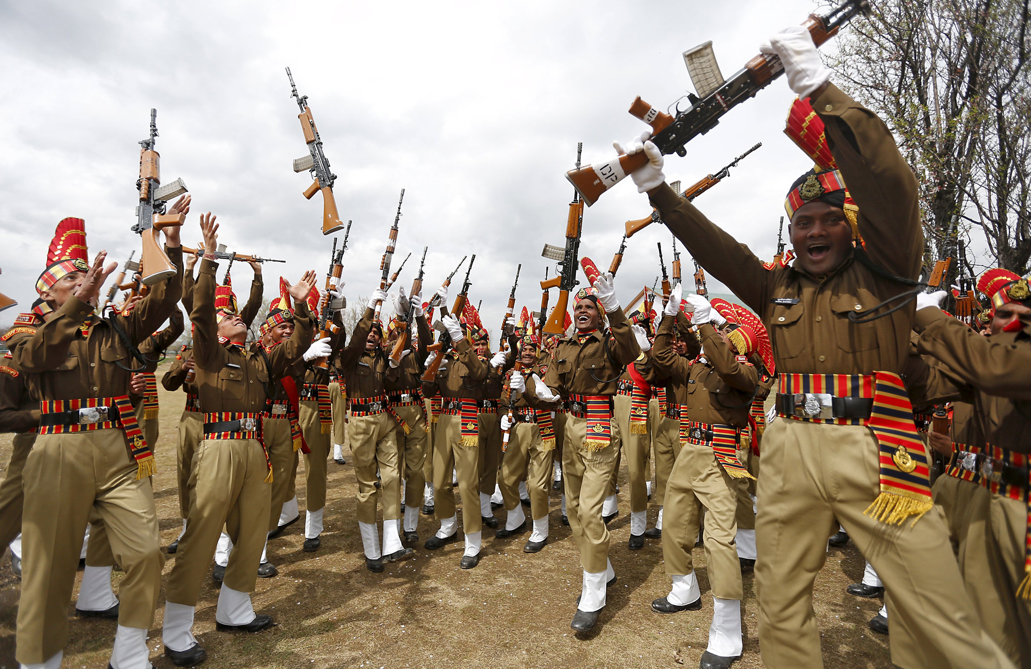 Indian Border Security Force personnel toss their rifles to celebrate after their passing-out parade in Humhama...Indian Border Security Force (BSF) personnel toss their rifles to celebrate after their passing-out parade in Humhama on the outskirts of Srinagar March 14, 2016. A total of 130 recruits on Monday were formally inducted into the BSF, an Indian paramilitary force mostly deployed along the borders, after completing 44 weeks of training, a BSF media release said. REUTERS/Danish Ismail