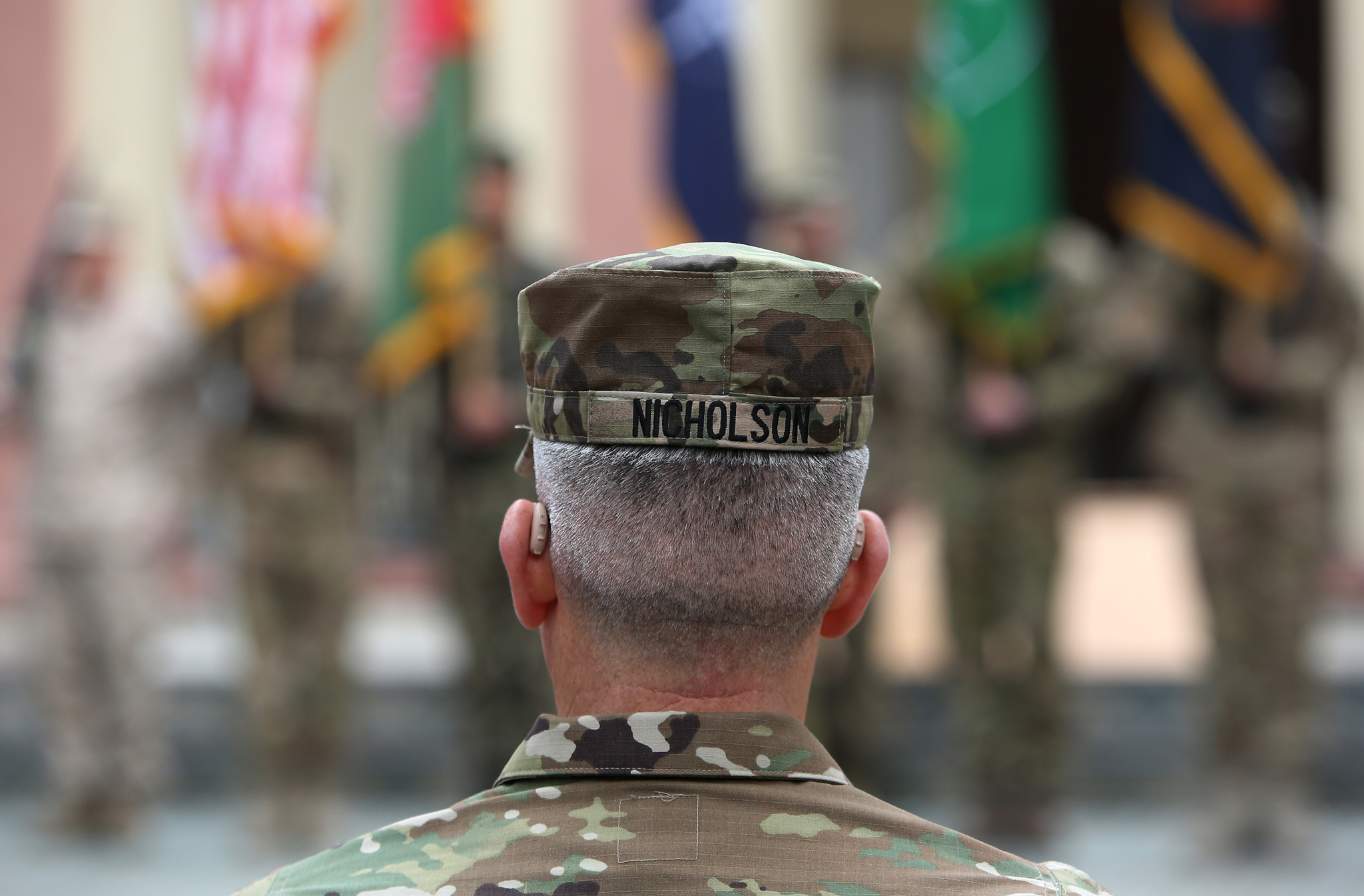New Commander of Resolute Support forces and United States forces in Afghanistan, U.S. Army General John Nicholson, attends a change of command ceremony in Resolute Support headquarters in Kabul, Afghanistan, Wednesday, March 2, 2016. (AP Photo/Rahmat Gul)