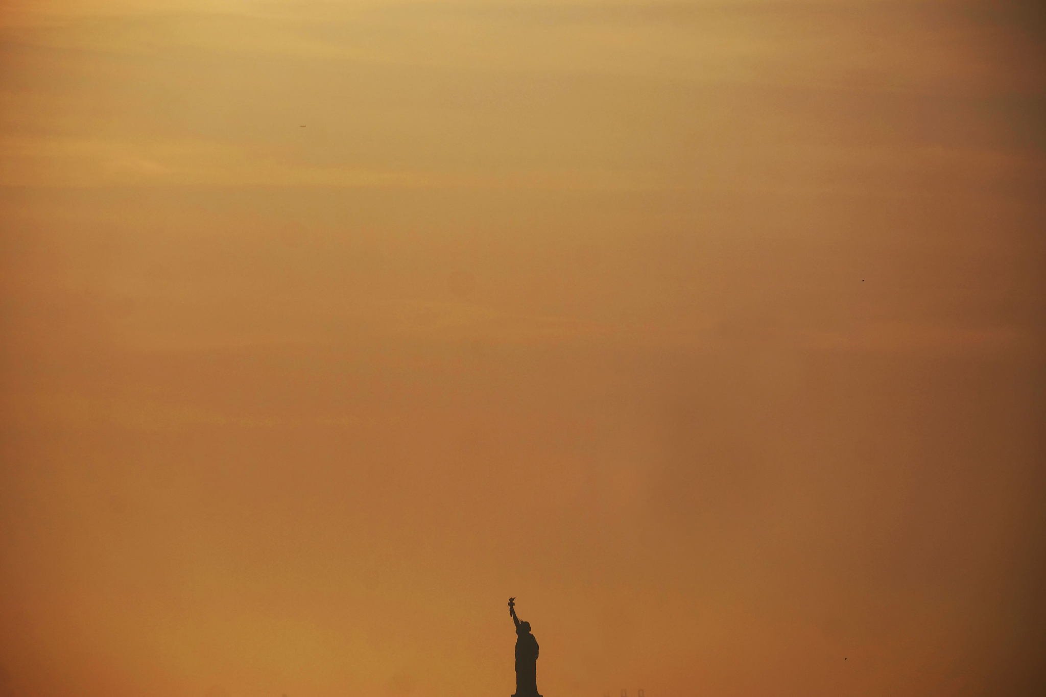 TOPSHOT - The Statue of Liberty is pictu...TOPSHOT - The Statue of Liberty is pictured during sunset in New York, on March 8, 2016.  / AFP / Jewel SAMADJEWEL SAMAD/AFP/Getty Images