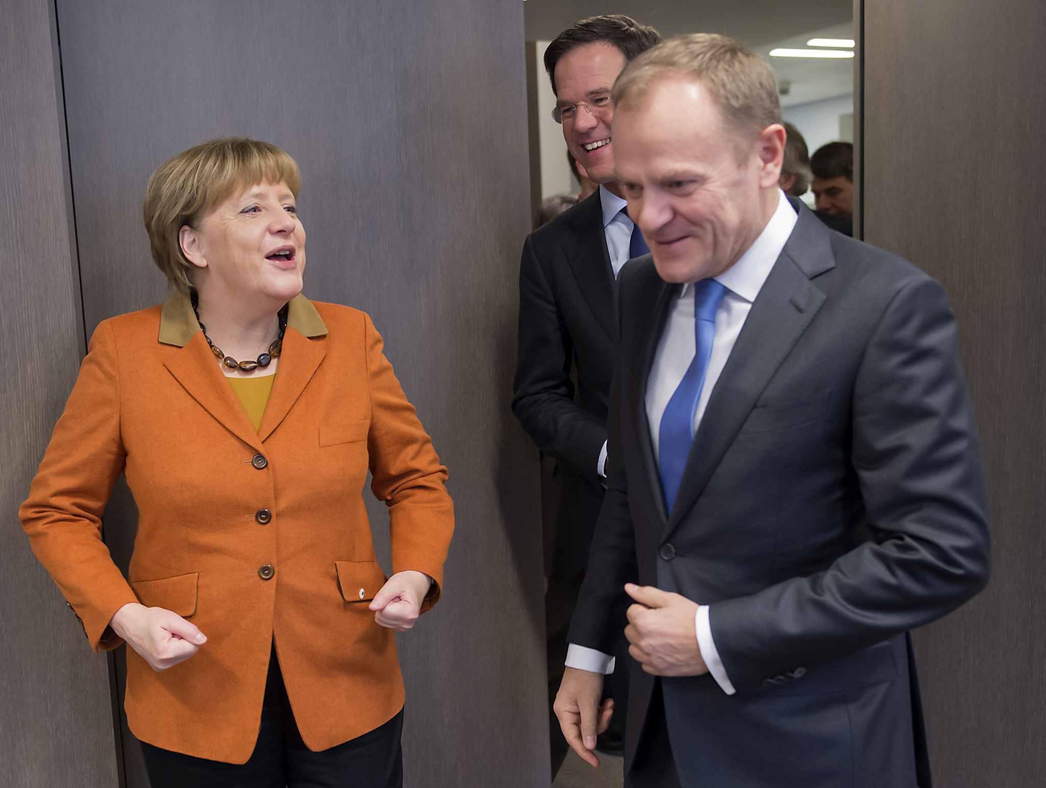German Chancellor Angela Merkel, left, speaks with European Council President Donald Tusk, right, during a meeting on the sidelines of an EU summit in Brussels on Monday, March 7, 2016. European Union leaders are holding a summit in Brussels on Monday with Turkey to discuss the current migration crisis.