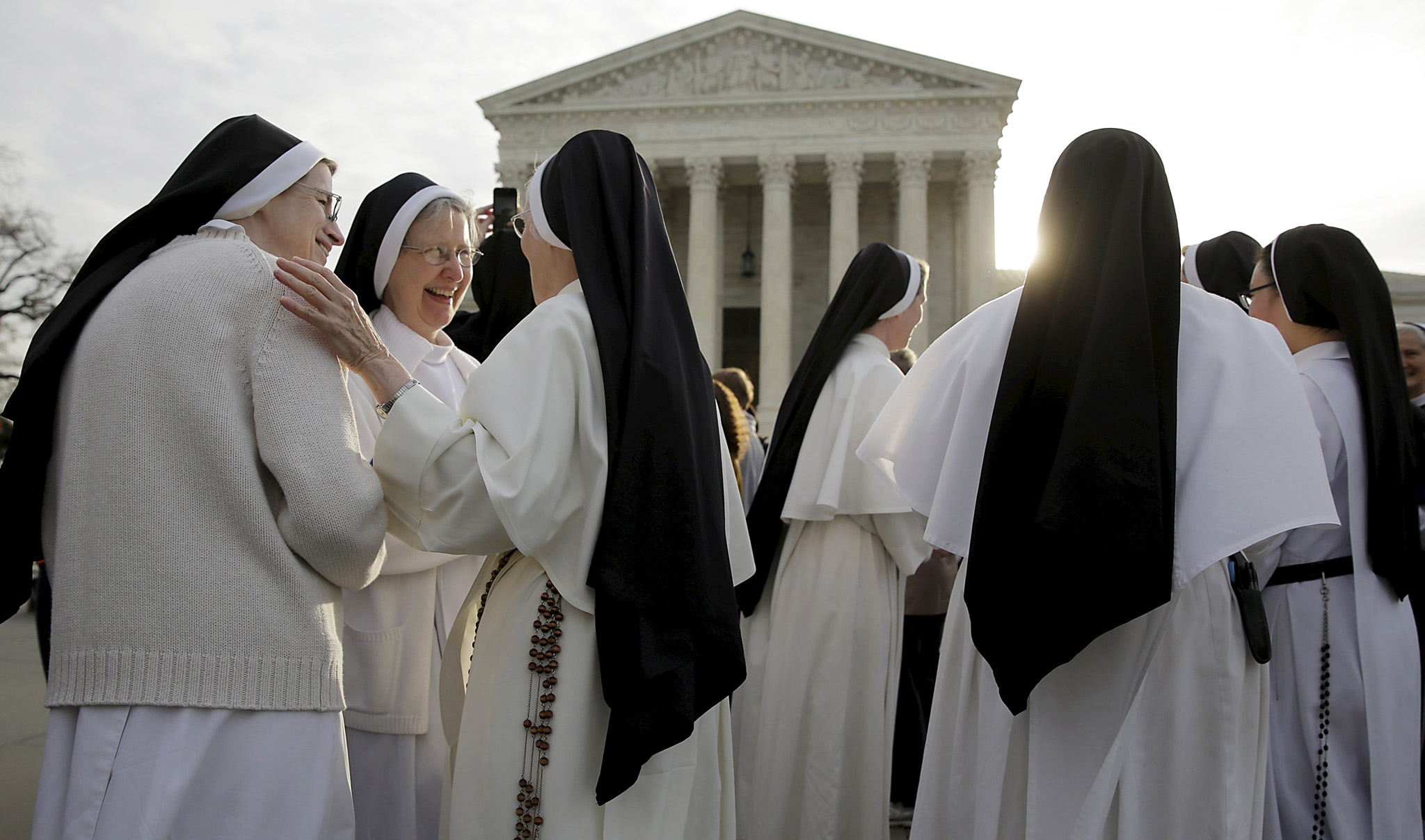 Nuns speak to each other before Zubik v. Burwell is heard by the U.S. Supreme Court in Washington...Nuns speak to each other before Zubik v. Burwell, an appeal brought by Christian groups demanding full exemption from the requirement to provide insurance covering contraception under the Affordable Care Act, is heard by the U.S. Supreme Court in Washington, March 23, 2016. REUTERS/Joshua Roberts