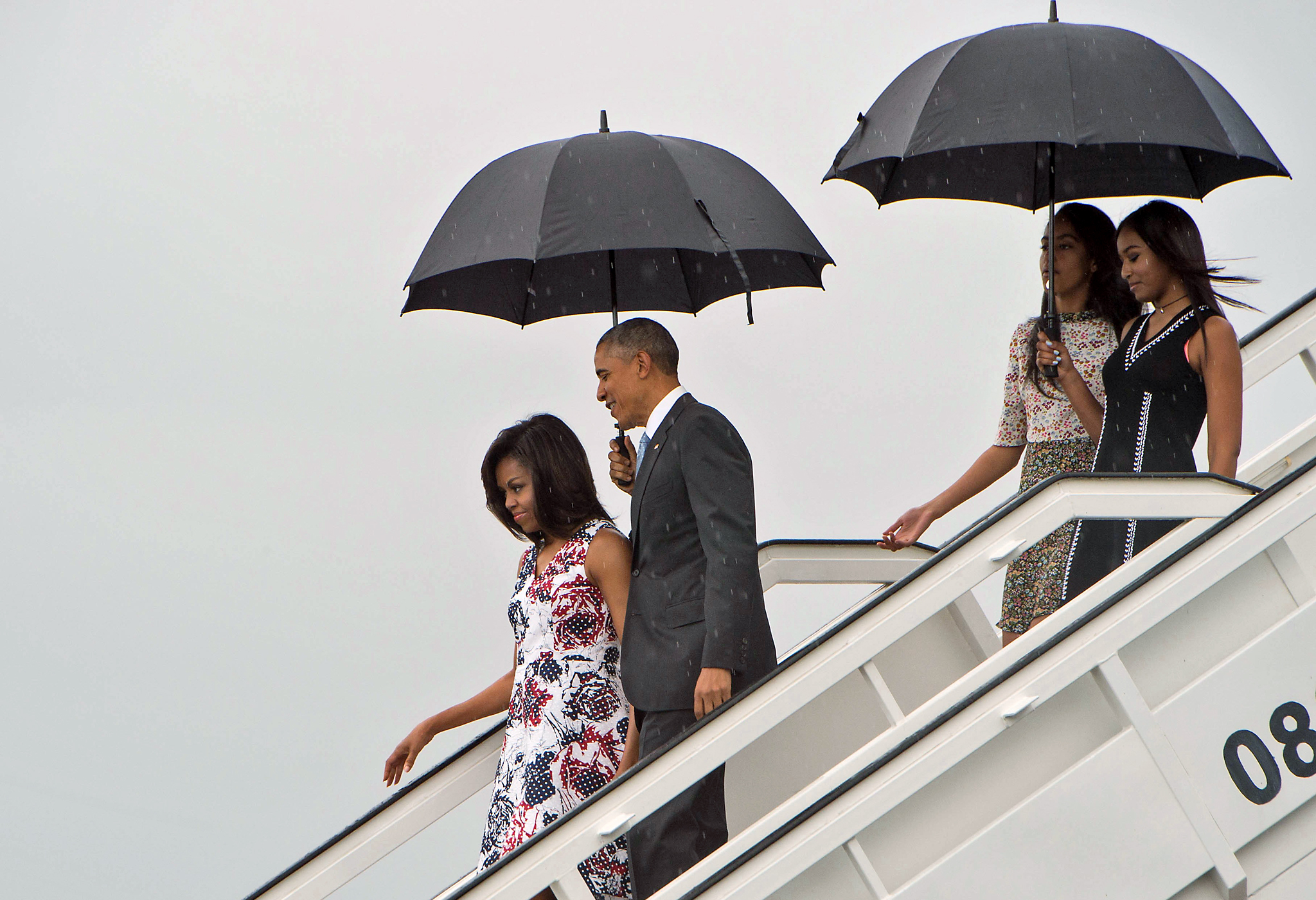 US President Barack Obama (2nd L), First...US President Barack Obama (2nd L), First Lady Michelle Obama (L) and daughters Malia (2nd R) and Sasha (R) disembark from Air Force One at the Jose Marti International Airport in Havana on March 20, 2016. Obama arrived in Cuba to bury the hatchet in a more than half-century-long Cold War conflict that turned the communist island and its giant neighbor into bitter enemies.     AFP PHOTO/Nicholas KAMMNICHOLAS KAMM/AFP/Getty Images