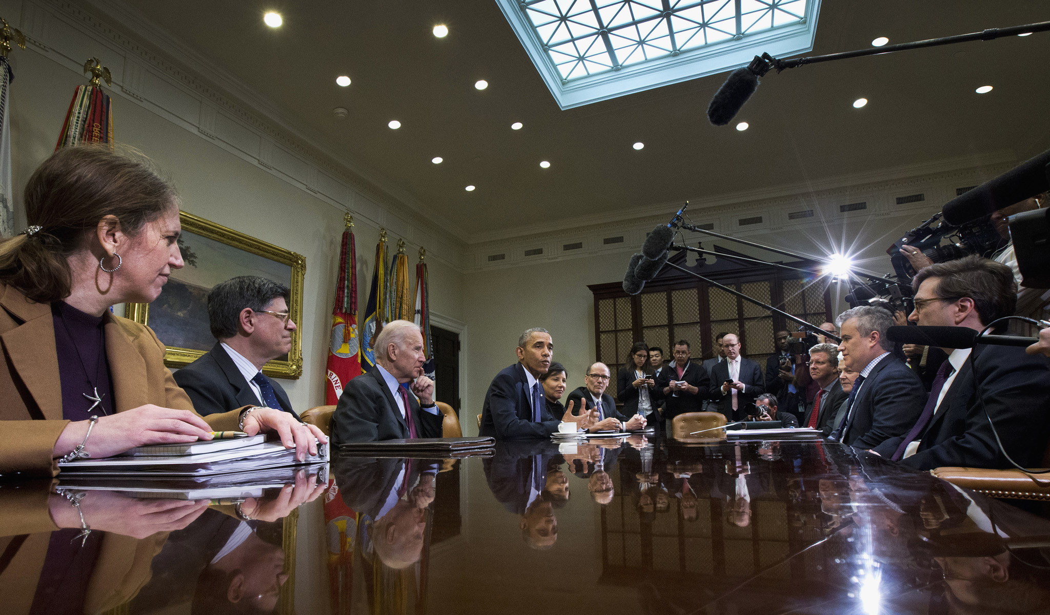 Barack Obama...President Barack Obama meets with members of his economic team in the Roosevelt Room of the White House in Washington, Friday, March 4, 2016. Obama spoke about U.S. employers adding 242,000 workers in February, driving another solid month for the resilient American job market.