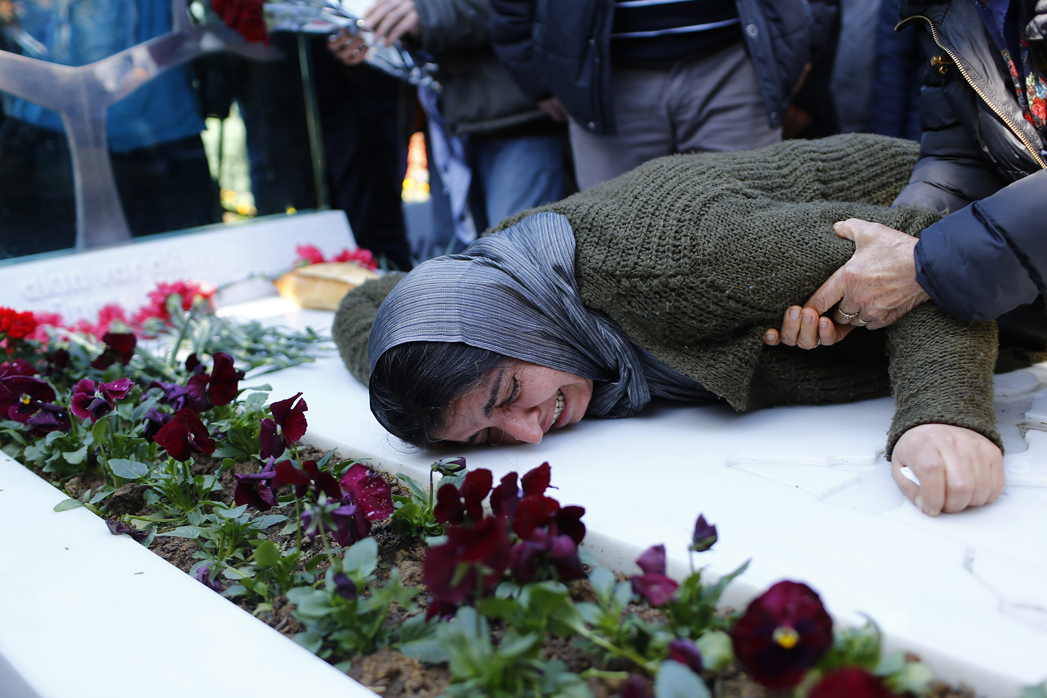Gulsum Elvan, mother of slain Berkin Elvan, mourns at her son's grave during a rally marking second anniversary of his death in Istanbul, Turkey. Berkin Elvan, 15 years old, died on 11 March 2014 after 296 days in a coma as a consequence of injuries suffered when he was hit by a gas canister during the police crackdown on protesters at Gezi Park in June 2013.