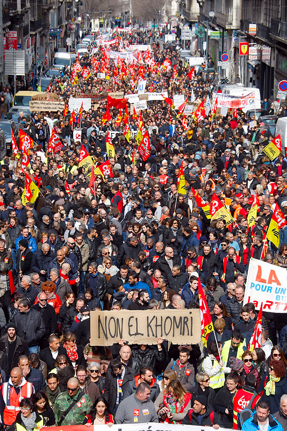 Employes, workers and students demonstrate in Marseille, southern France, Wednesday, March, 9, 2016. France's transport unions and youth organizations hold strikes, amid anger over proposed labor law changes that take aim at the 35-hour workweek and make layoffs easier. (AP Photo/Claude Paris)