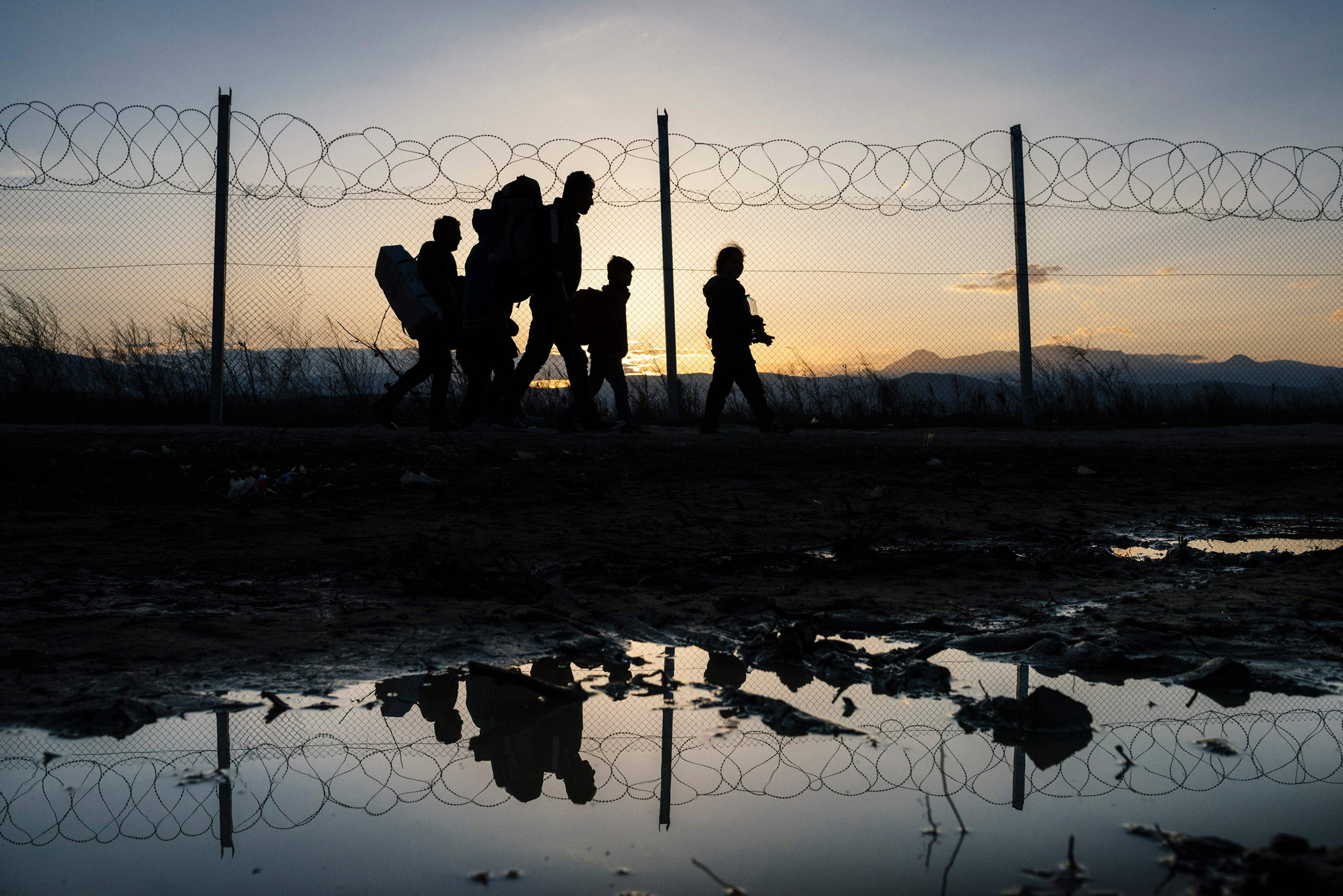 Refugees walk to a registration camp after crossing the border  Greek-Macedonian near the town of Gevgelija