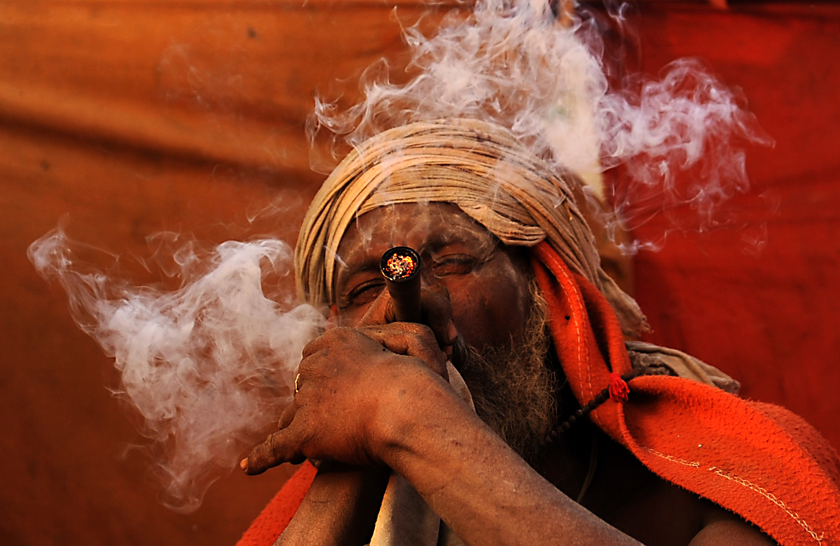 TOPSHOT - A Sadhu (Hindu holy man), smok...TOPSHOT - A Sadhu (Hindu holy man), smokes a chillum, a traditional clay pipe, as a holy offering to Lord Shiva, the Hindu god of creation and destruction near the Pashupatinath Temple in Kathmandu on March 6, 2016, on the eve of the Hindu festival Maha Shivaratri. Hindus mark the Maha Shivratri festival by offering special prayers and fasting.  / AFP / PRAKASH MATHEMAPRAKASH MATHEMA/AFP/Getty Images