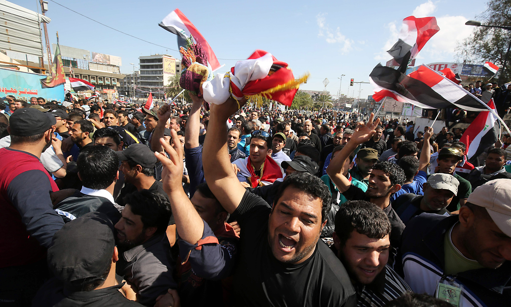 Supporters of Iraqi Shiite cleric Moqtad...Supporters of Iraqi Shiite cleric Moqtada al-Sadr wave national flags during a demonstration calling for governmental reform and elimination of corruption on March 18, 2016, outside the main gates of Baghdad's Green Zone. Thousands of supporters of Iraqi cleric Moqtada Sadr defied a government ban to launch sit-ins at the main gates of Baghdad's Green Zone aimed at pushing for reforms. / AFP PHOTO / AHMAD AL-RUBAYEAHMAD AL-RUBAYE/AFP/Getty Images