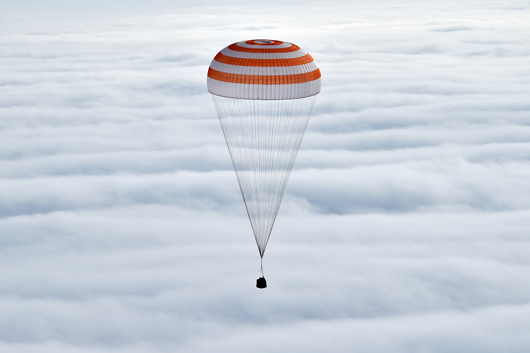 Soyuz TMA-18M space capsule carrying the International Space Station (ISS) crew members prepares to land in a remote area outside the town of Dzhezkazgan, Kazakhstan