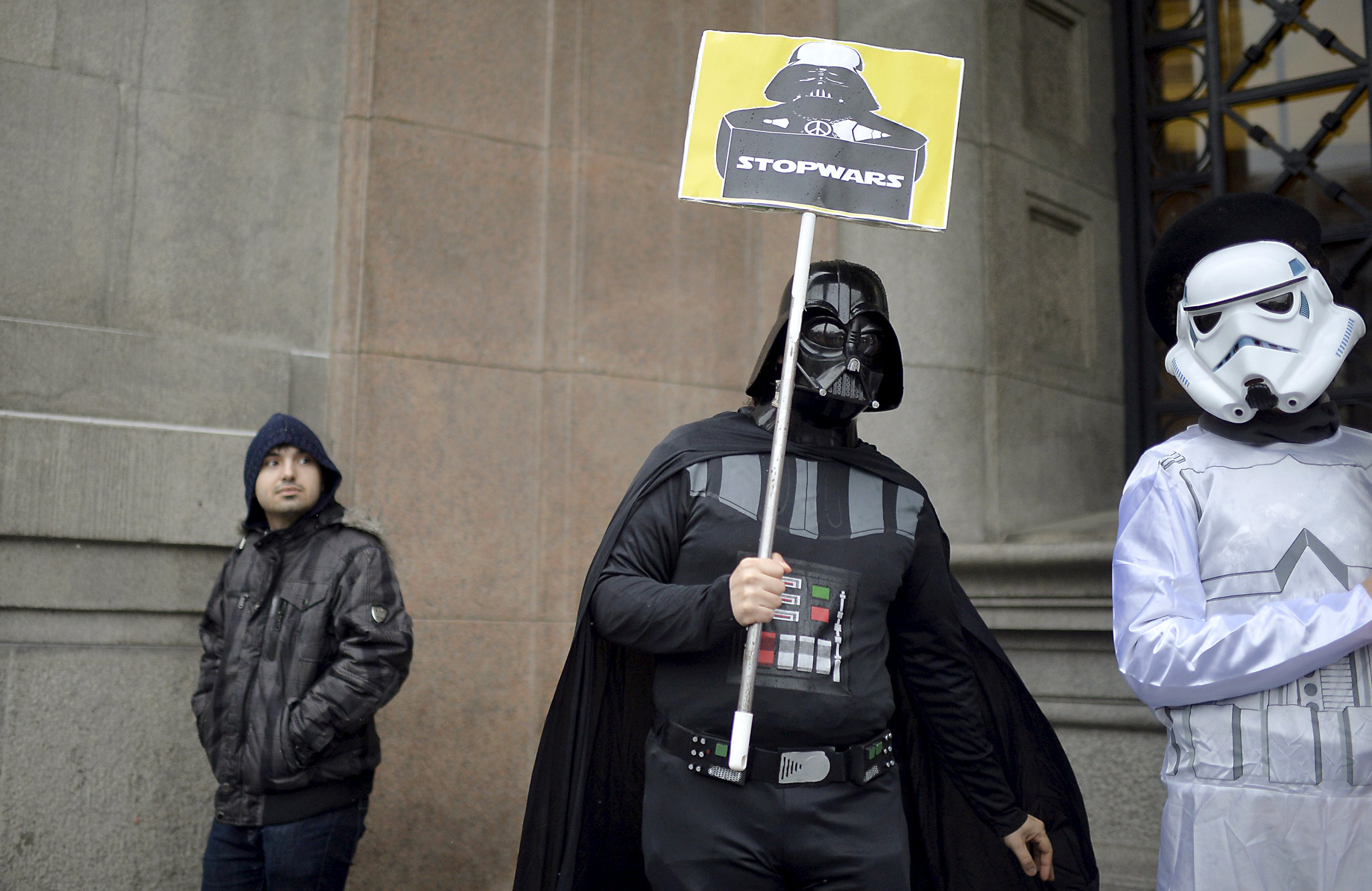 Protesters dressed as Star Wars characters take part in a protest against military spending in Bilbao...Protesters dressed as Darth Vader and stormtrooper from the film series Star Wars take part in a demonstration against military spending and in favour of aid for refugees ahead of the thirtieth anniversary of the referendum on Spain's membership in NATO, in Bilbao, northern Spain March 9, 2016. REUTERS/Vincent West