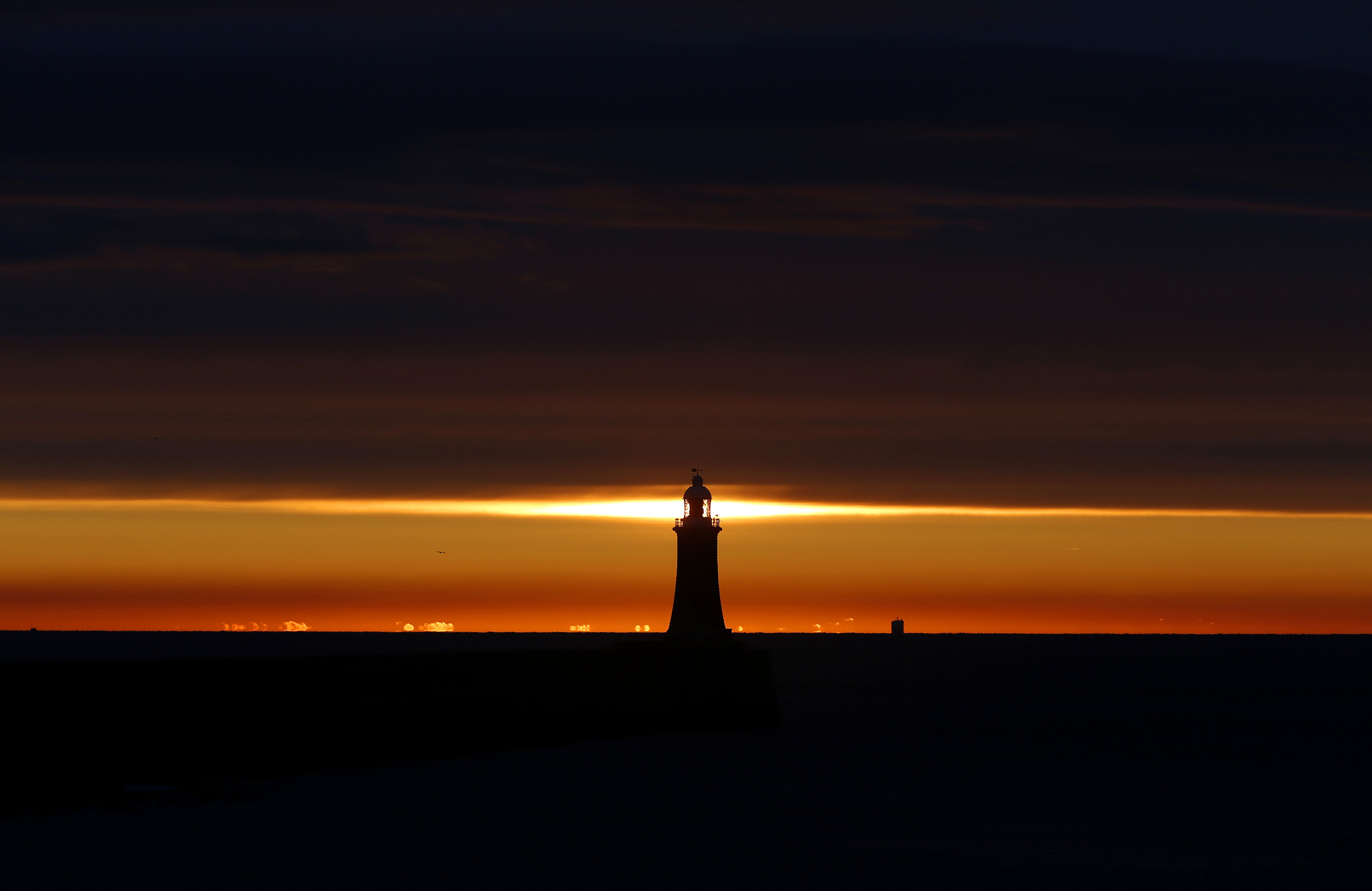 Spring weather Mar 8th 2016...The sun rises over the North Sea as a ship heads into the mouth of the river Tyne in Tynemouth, as signs of spring will start to show at the end of this week with climbing temperatures across the UK. PRESS ASSOCIATION Photo. Picture date: Tuesday March 8, 2016. The Met Office said there will be more sun and increasingly mild conditions nationwide, with levels rising from Thursday as a tropical maritime air travels up. See PA story WEATHER Spring. Photo credit should read: Owen Humphreys/PA Wire