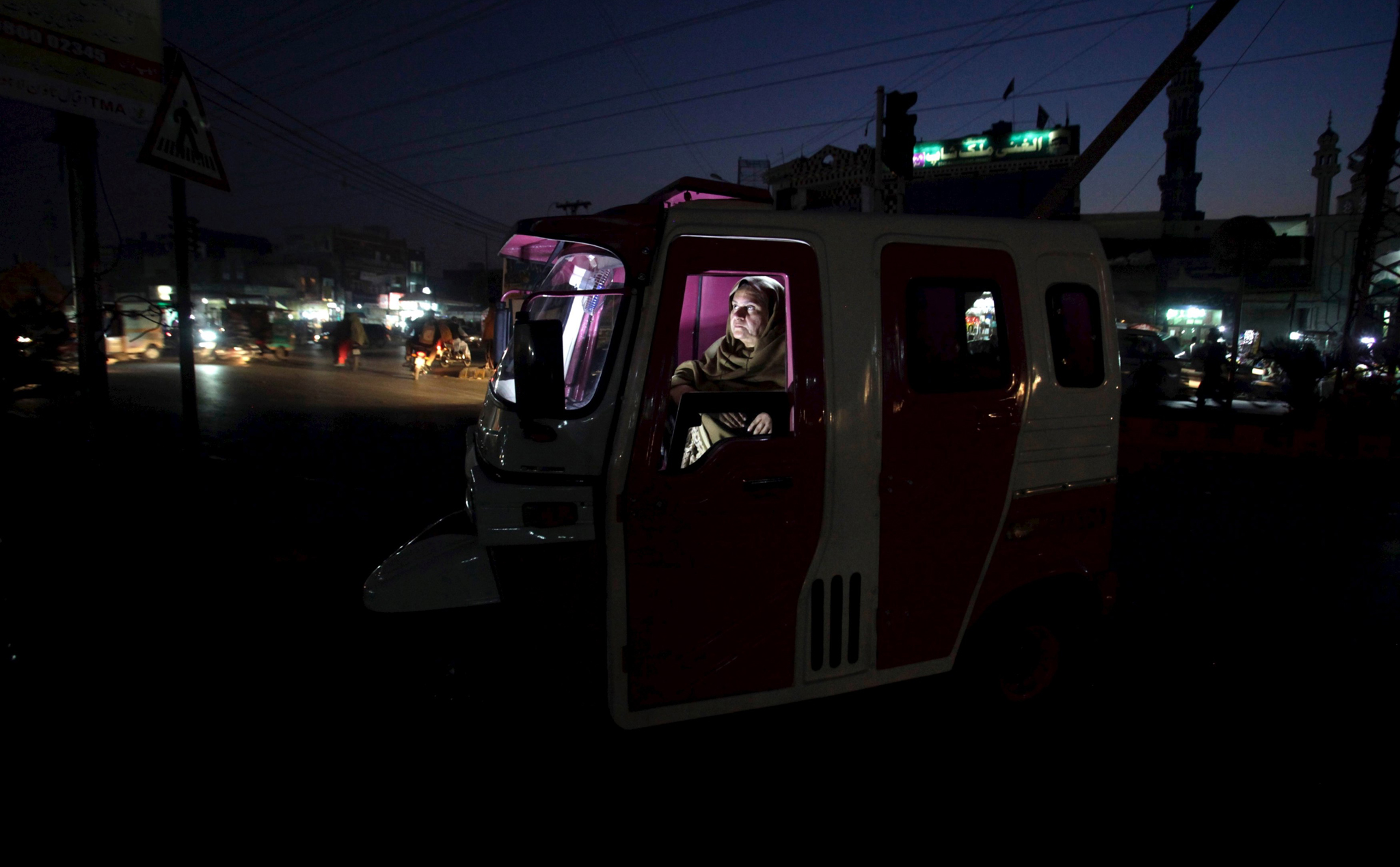 "The Wider Image: Pakistan's 'Pink Rickshaw'...Pakistan's first women-only rickshaw service was meant to provide its staff with a new way of gaining financial independence and its passengers with the chance of a ride without being groped and harassed by male drivers. But, after just a year in business, the ""Pink Rickshaw"" in the Punjabi city of Lahore, is struggling. REUTERS/Mohsin Raza    To match PAKISTAN-RICKSHAWS/           SEARCH ""PINK RICKSHAW"" FOR THIS STORY. SEARCH ""THE WIDER IMAGE"" FOR ALL STORIES TEMPLATE OUT   TPX IMAGES OF THE DAY"