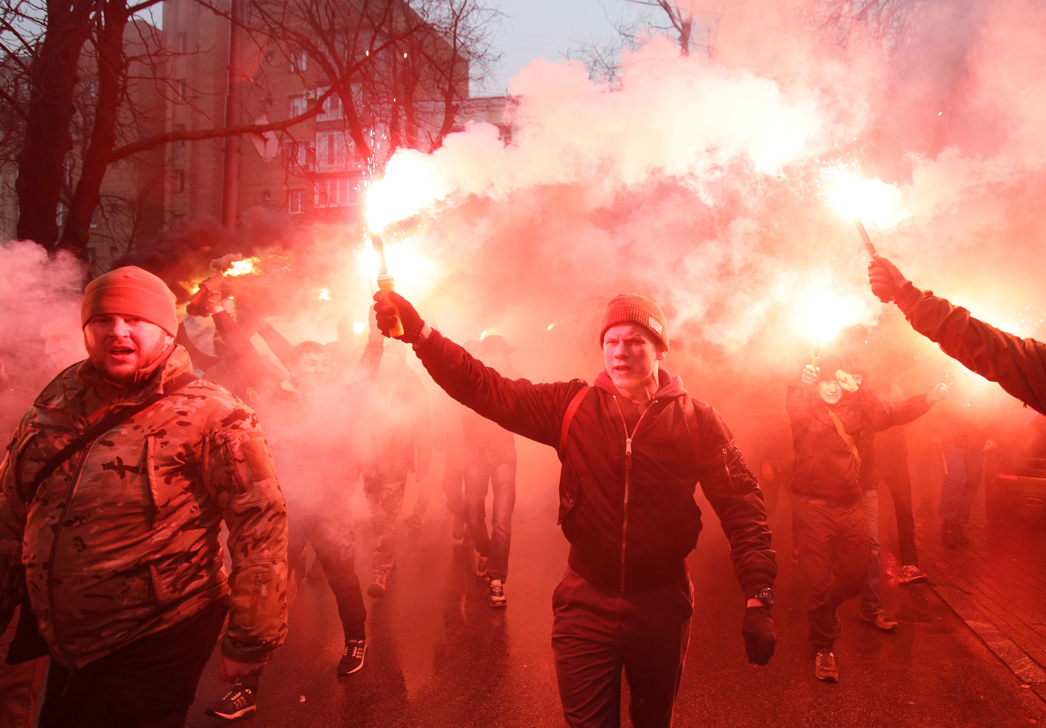 "Members of the Ukrainian volunteer batta...Members of the Ukrainian volunteer battalion Azov hold flares during a protest outside the Ukrainian Security Services (SBU) prison in Kiev on March 1, 2016. The protesters are demanding the release of Stanislav Krasnov, head of the nationalist organisation ""Azov-Crimea"", who is accused of spying for Russia. / AFP / ANATOLII STEPANOVANATOLII STEPANOV/AFP/Getty Images"