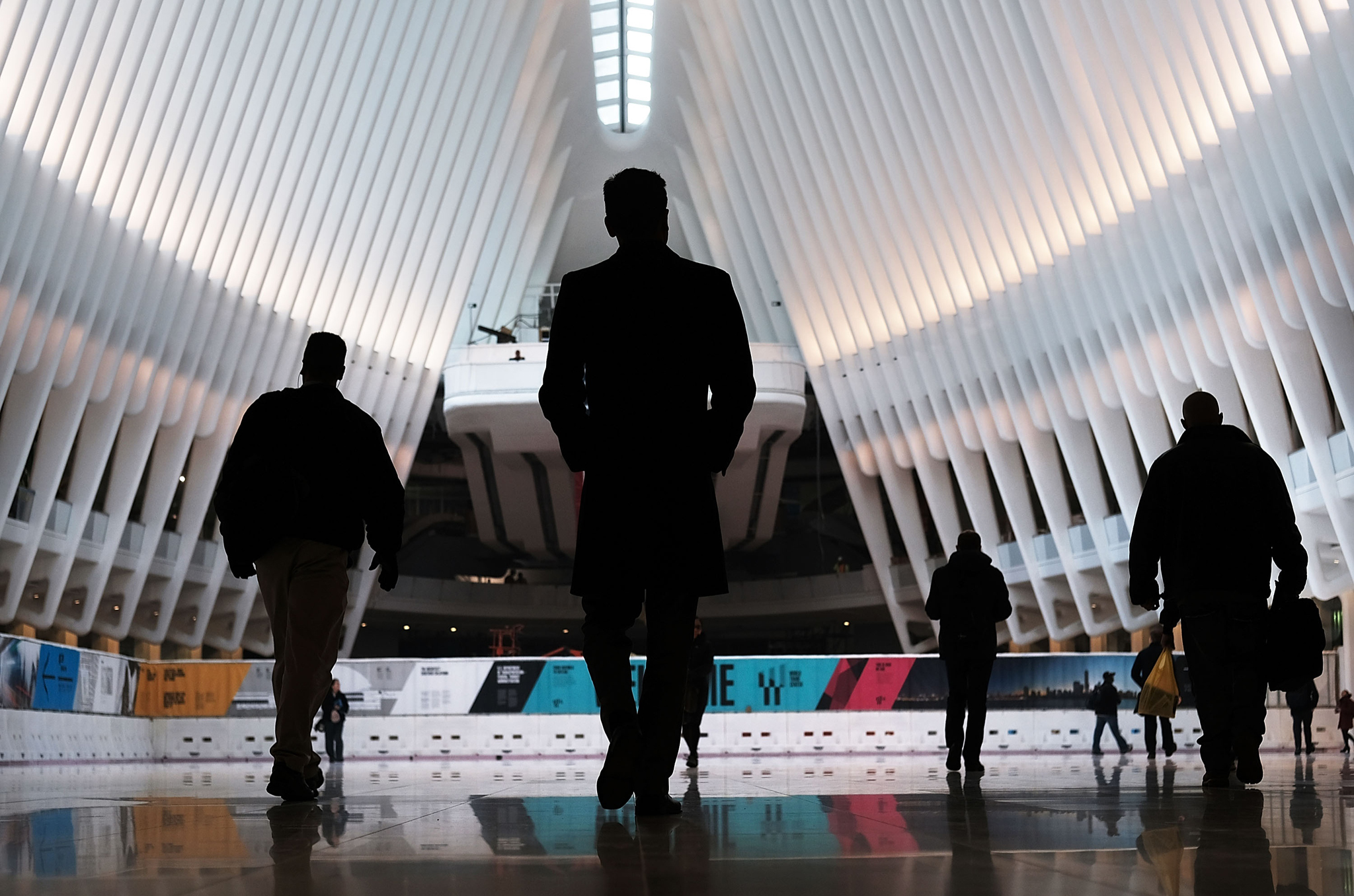 "New WTC State-Of-The-Art Transportation Hub ""Oculus"" Opens To The Public...NEW YORK, NY - MARCH 07: Commuters walk through the Oculus of the partially opened World Trade Center Transportation Hub after nearly 12 years of construction on March 7, 2016 in New York City. The grand structure was designed by Spanish architect Santiago Calatrava at a cost of $4 billion in public money, almost $2 billion over budget. The hub offers connections to the PATH train connecting New York City and New Jersey. (Photo by Spencer Platt/Getty Images)"