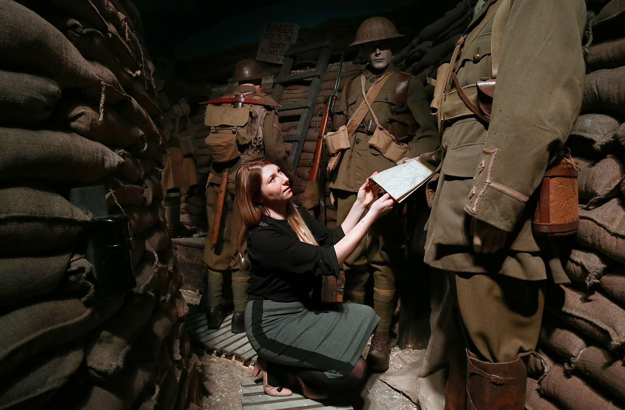 "***BESTPIX*** Preview Of Remembering 1916 - Life on the Western Front Exhibition...CROYDON, ENGLAND - MARCH 08:  A member of staff poses next to British World War One soldiers in a recreated trench during a press preview for the ""Remembering 1916 - Life on the Western Front"" exhibition at Whitgift School on March 8, 2016 in Croydon, England. The exhibition presents 1916 and the First World War as seen by Britain, France and Germany and will run from March 12 to August 31 2016.  (Photo by Carl Court/Getty Images) ***BESTPIX***"