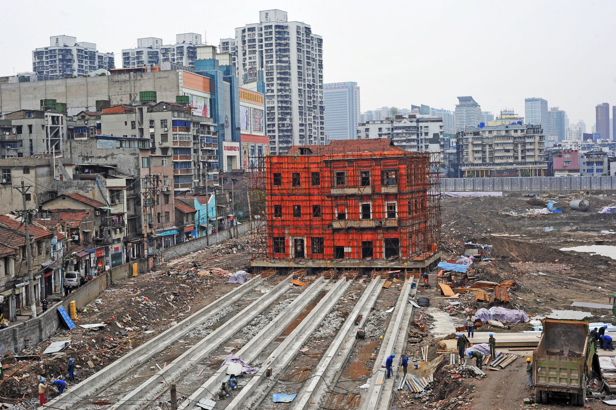 A historical building is seen being moved to make way for new constructions in Wuhan...A historical building is seen being moved to make way for new constructions in Wuhan, Hubei Province, China, in this picture taken March 9, 2016. REUTERS/Stringer ATTENTION EDITORS - THIS PICTURE WAS PROVIDED BY A THIRD PARTY. THIS PICTURE IS DISTRIBUTED EXACTLY AS RECEIVED BY REUTERS, AS A SERVICE TO CLIENTS. CHINA OUT. NO COMMERCIAL OR EDITORIAL SALES IN CHINA.
