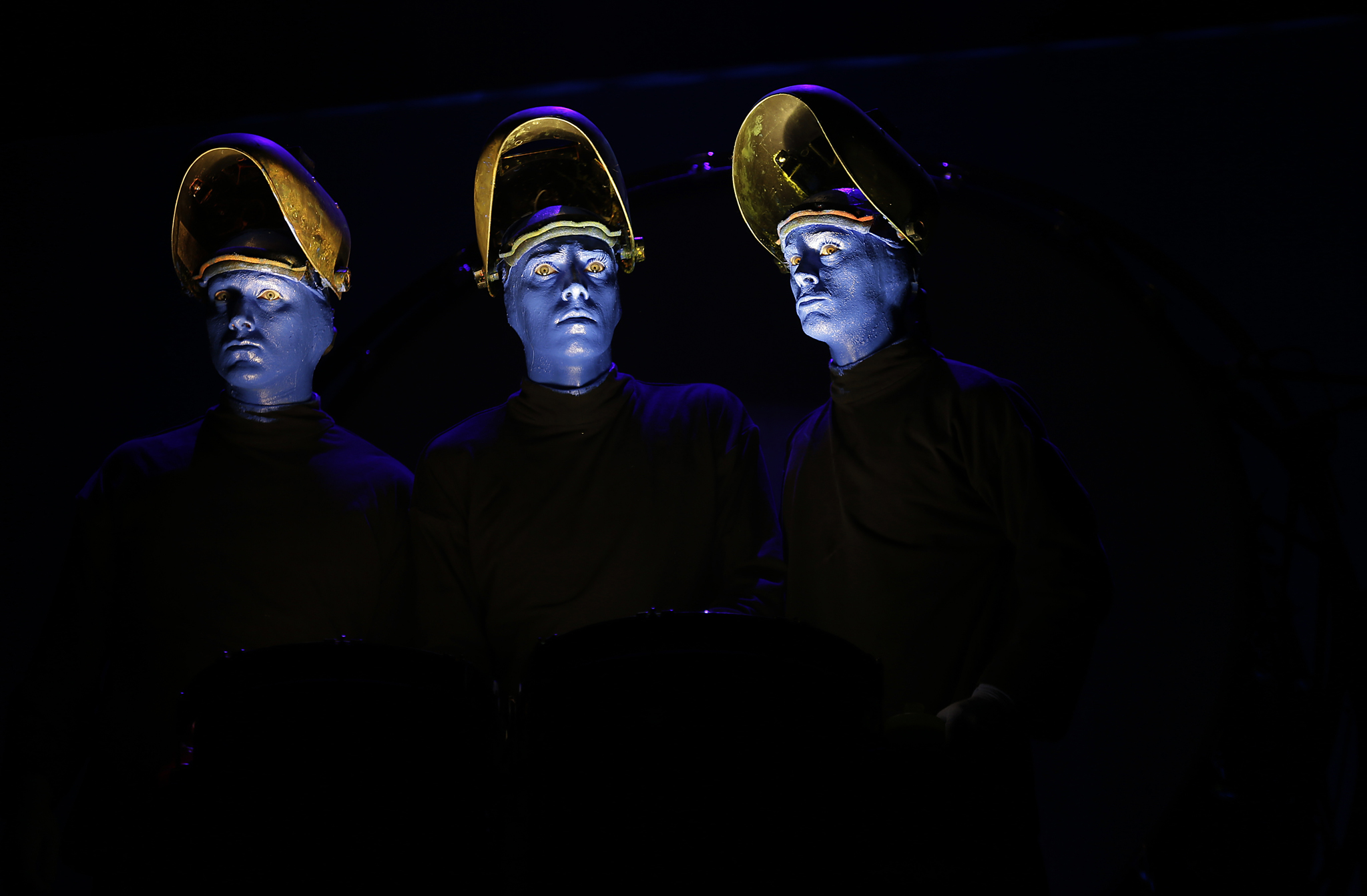 Blue Man Group performs during a media preview in Singapore