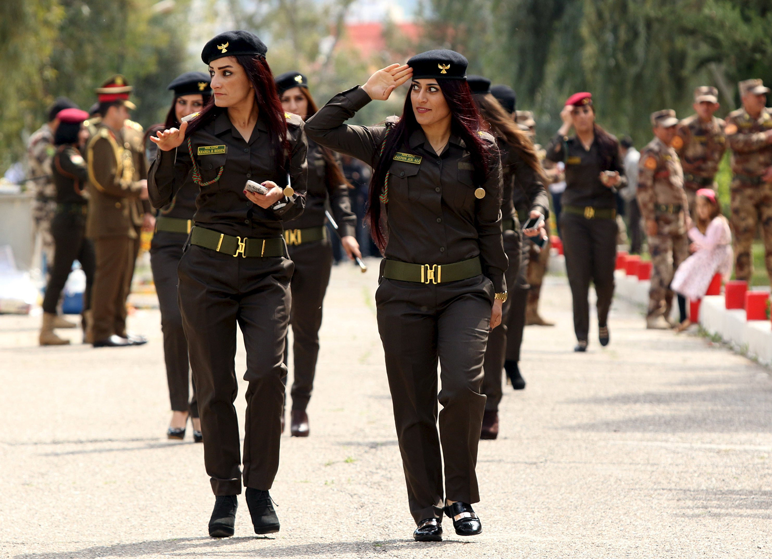 Female Kurdish Peshmerga attend their graduation ceremony at a police academy in Zakho