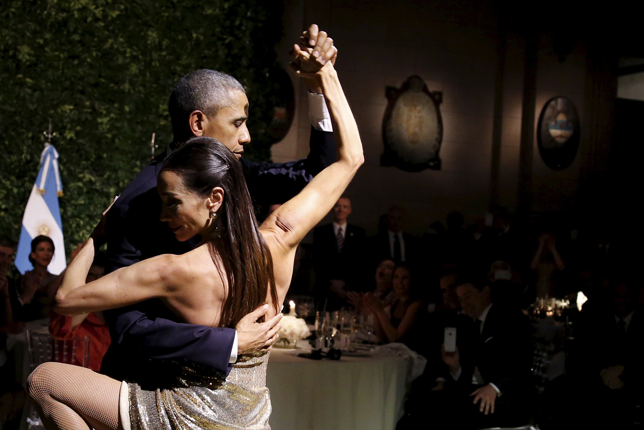 U.S. President Barack Obama dances tango during a state dinner hosted by Argentina's President Mauricio Macri at the Centro Cultural Kirchner as part of President Obama's two-day visit to Argentina, in Buenos Aires