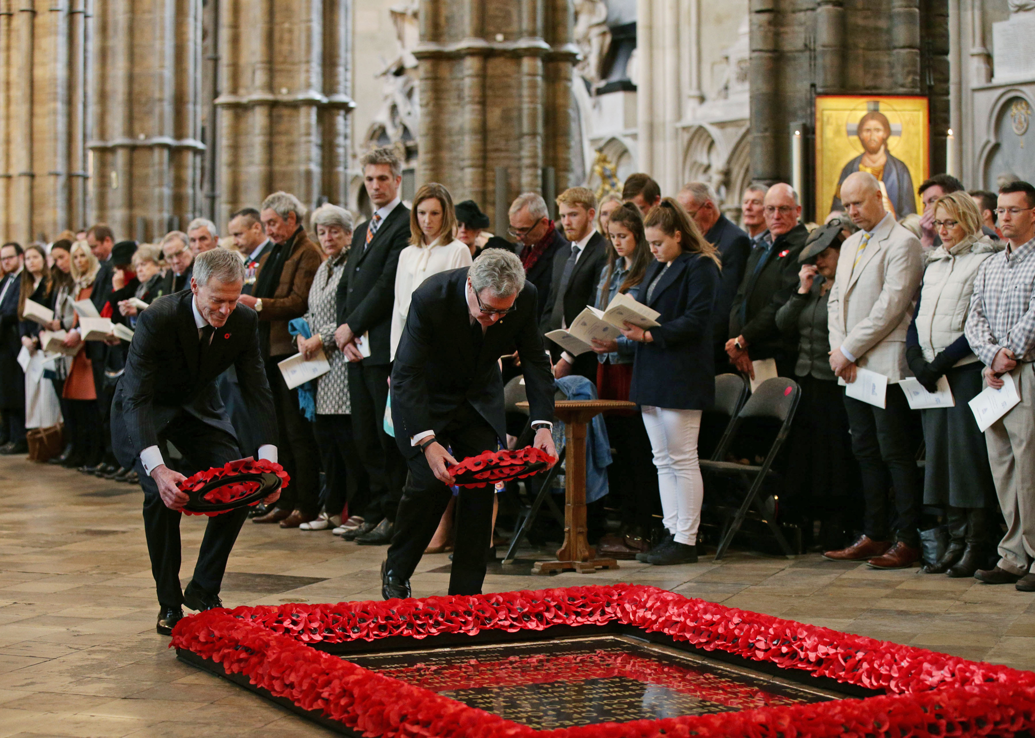 His Excellency the Rt Hon Sir Lockwood Smith (left), High Commissioner for New Zealand, and His Excellency the Hon Alexander Downer AC,High Commissioner for Australia, laying wreaths at the Tomb of the Unknown Warrior during the annual Service of Commemoration and Thanksgiving to Mark ANZAC Day at Westminster Abbey, London. PRESS ASSOCIATION Photo. Picture date: Monday April 25, 2016. Anzac Day has been commemorated in the capital since the first anniversary of the Anzac landings at Gallipoli in 1916, when King George V attended a service at Westminster Abbey.