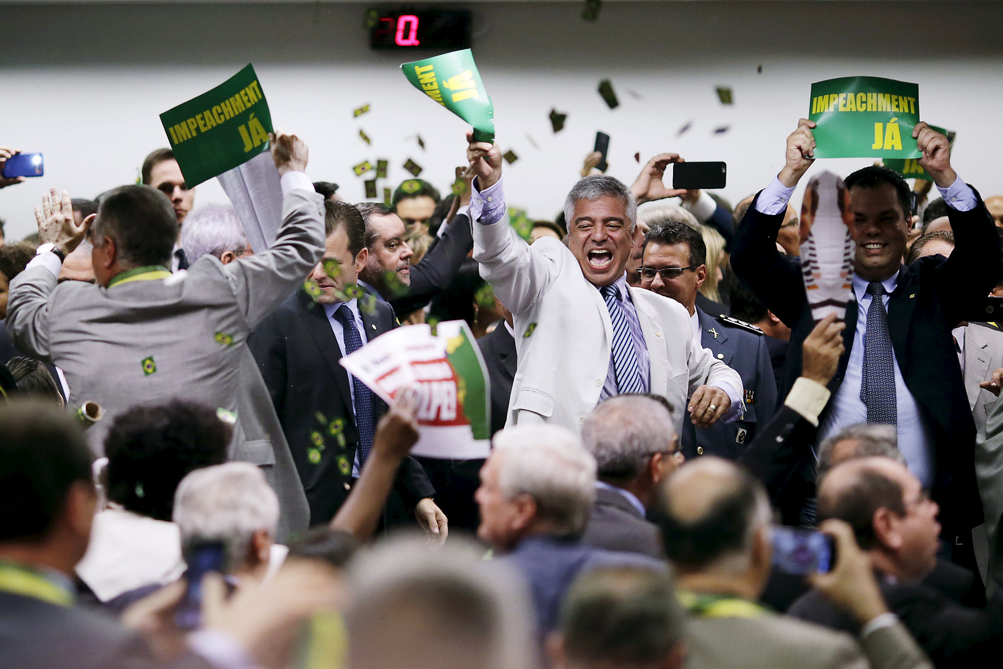 Members of the impeachment committee celebrate after voting on the impeachment of Brazilian President Dilma Rousseff at the National Congress in Brasilia...Members of the impeachment committee celebrate after voting on the impeachment of Brazilian President Dilma Rousseff at the National Congress in Brasilia, Brazil April 11, 2016. REUTERS/Ueslei Marcelino      TPX IMAGES OF THE DAY