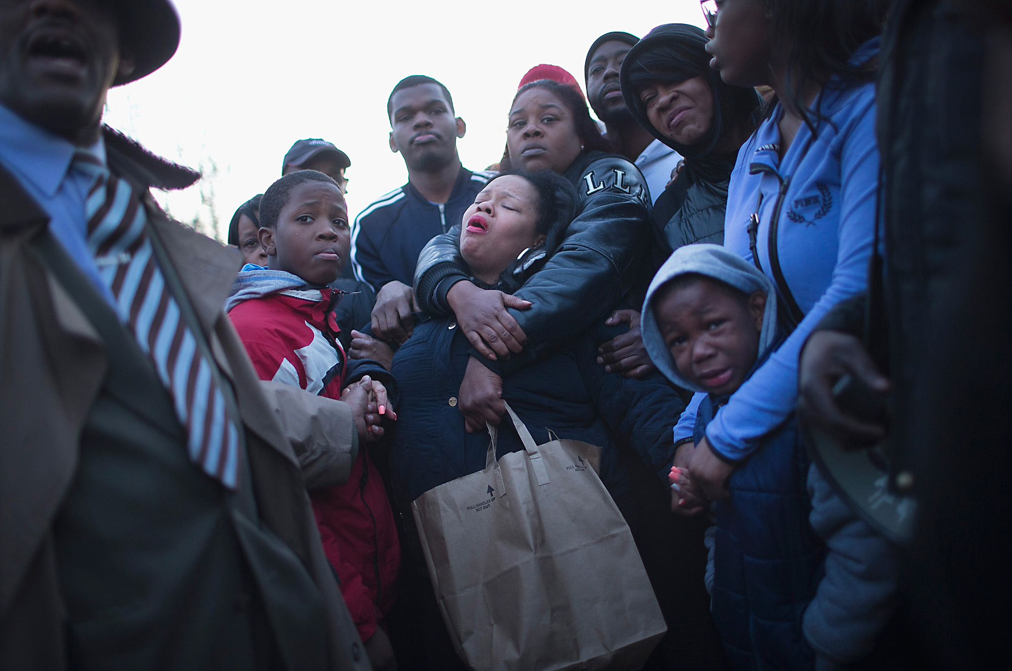 "Chicago Police Shoot And Kill Teen On City's West Side...CHICAGO, ILLINOIS - APRIL 12:  Tambrasha Hudson (C) is comforted as she joins demonstrators protesting the shooting death of her son 16-year-old Pierre Loury near the location where he was killed on April 12, 2016 in Chicago, Illinois. Police have said Loury took off running when the vehicle he was in was pulled over by police because it matched the description of a vehicle used in an earlier drive-by shooting. The chase, according to police, ended with an ""armed confrontation"".  (Photo by Scott Olson/Getty Images)"