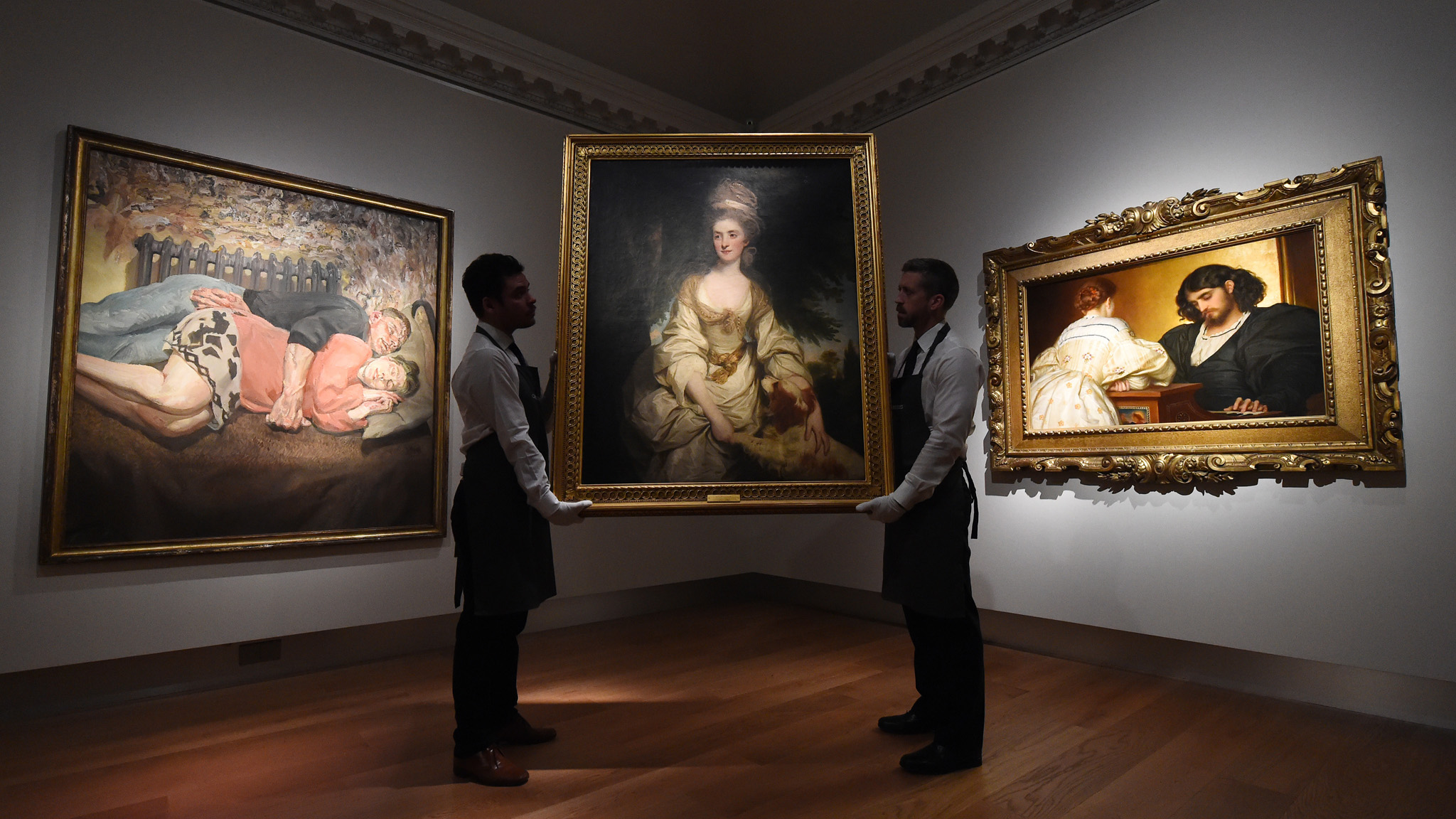 "Christie's Unveil Three Important Works From Their Summer Sale...LONDON, ENGLAND - APRIL 28:  (L-R) ""Ib and Her Husband"" 1992 by Lucian Freud, estimate on request in the region of 18 million pounds, ""Portrait of Lucy Long, Mrs George Hardinge"" 1778 by Sir Joshua Reynolds P.R.A, estimate 2-3 million pounds, and ""Golden Hours"" 1864 by Frederic, Lord Leighton, estimate 3-5 million pounds on April 28, 2016 in London, England. Christie's has unveiled three major paintings spanning three centuries for its Summer Sale to celebrate its 250th Anniversary.  (Photo by Eamonn M. McCormack/Getty Images)"