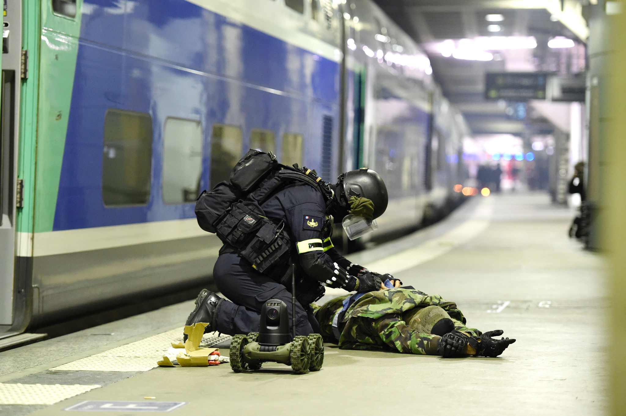 A member of the National Gendarmerie Intervention Group (GIGN) deactivates a bomb from a supposed terrorist during a training exercise in the event of a terrorist attack in collaboration with Recherche Assistance Intervention Dissuasion (RAID) and Research and Intervention Brigades (BRI) in presence of the French Interior minister Bernard Cazeneuve at la Gare Montparnasse, center Paris