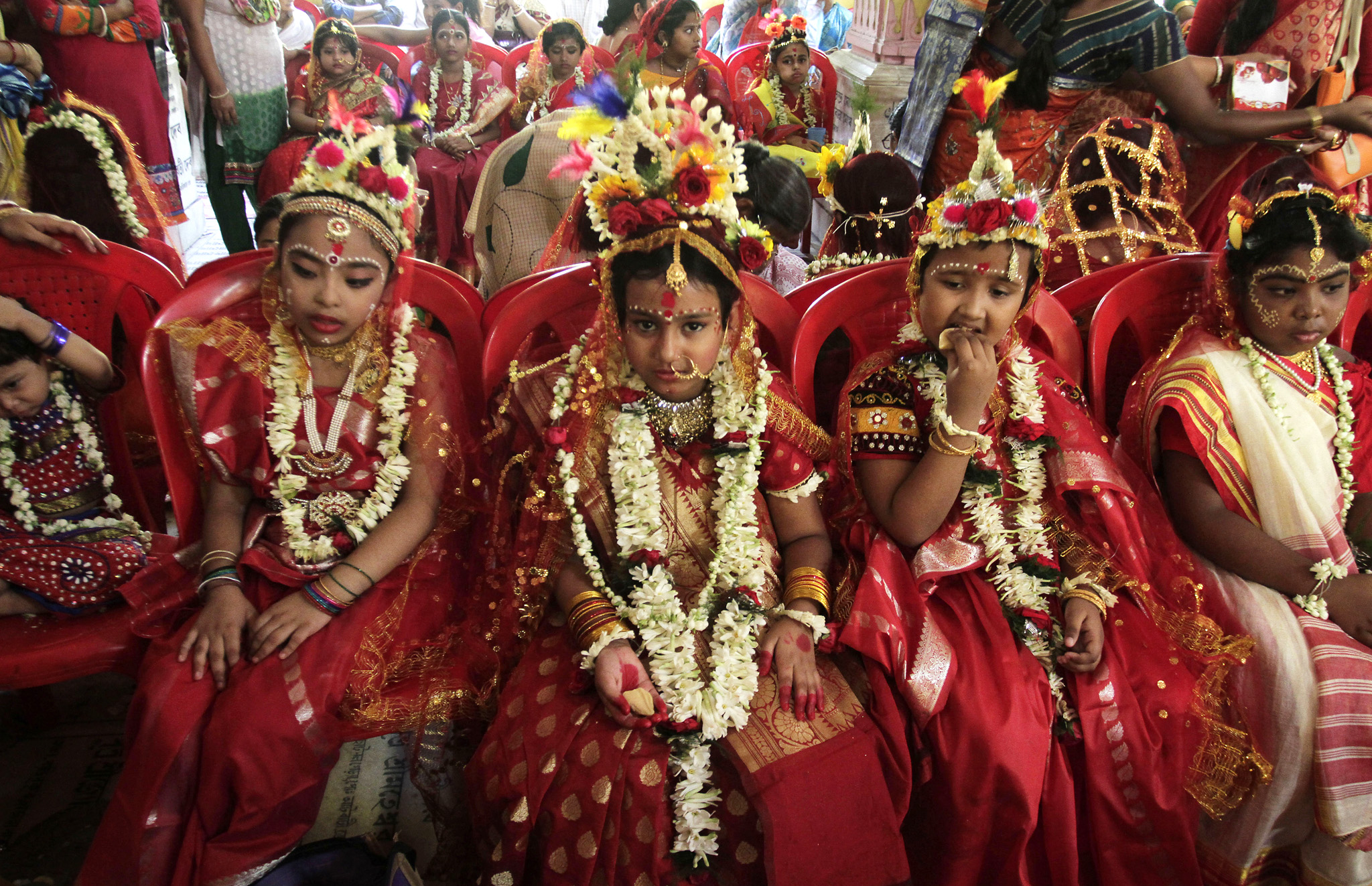 Young girls yet to attain puberty are dressed up as living goddesses before being worshipped as 'kumari' or virgin during the Bengali Hindu festival of Basanti Durga puja performed in the spring in Kolkata, India, Friday, April 15, 2016. Worshipping kumaris or virgins on the ninth day or navami of the festival is an important ritual when they are worshipped as the base power of all creation. The more popular form of Durga festival is performed in autumn when the Hindu mythical figure Rama is said to have called upon goddess Durga to seek her blessings to defeat the evil character Ravana. (AP Photo/ Bikas Das)
