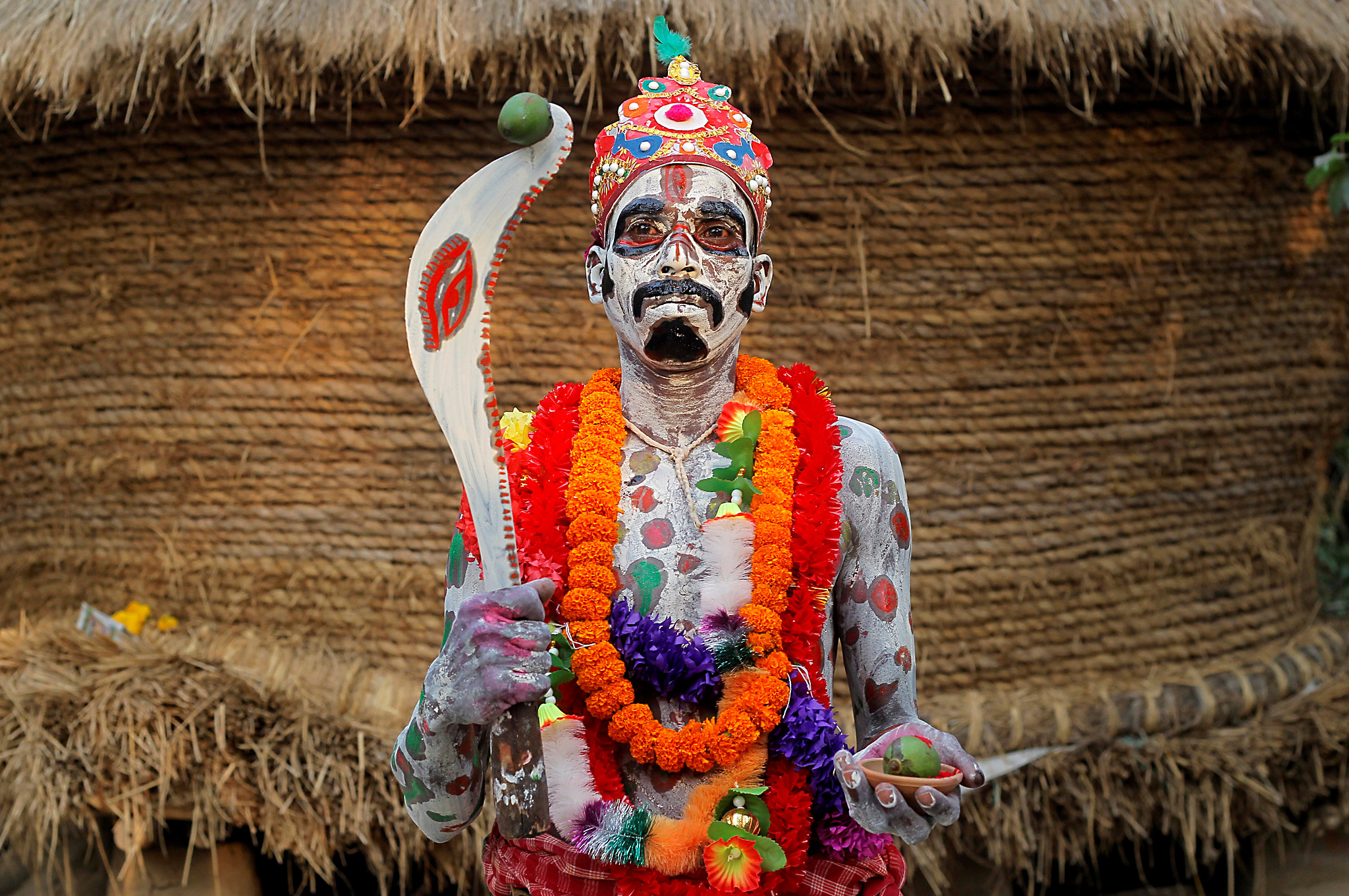 A devotee with his body painted poses as he waits to perform during a ritual as part of the annual Shiva Gajan religious festival at Sona Palasi village, in West Bengal, India, April 11, 2016. Devotees offer sacrifices and perform acts of devotion during the festival in the hopes of winning the favour of Hindu god Shiva and ensuring the fulfillment of their wishes, and also to mark the end of the Bengali calendar year. REUTERS/Rupak De Chowdhuri TPX IMAGES OF THE DAY