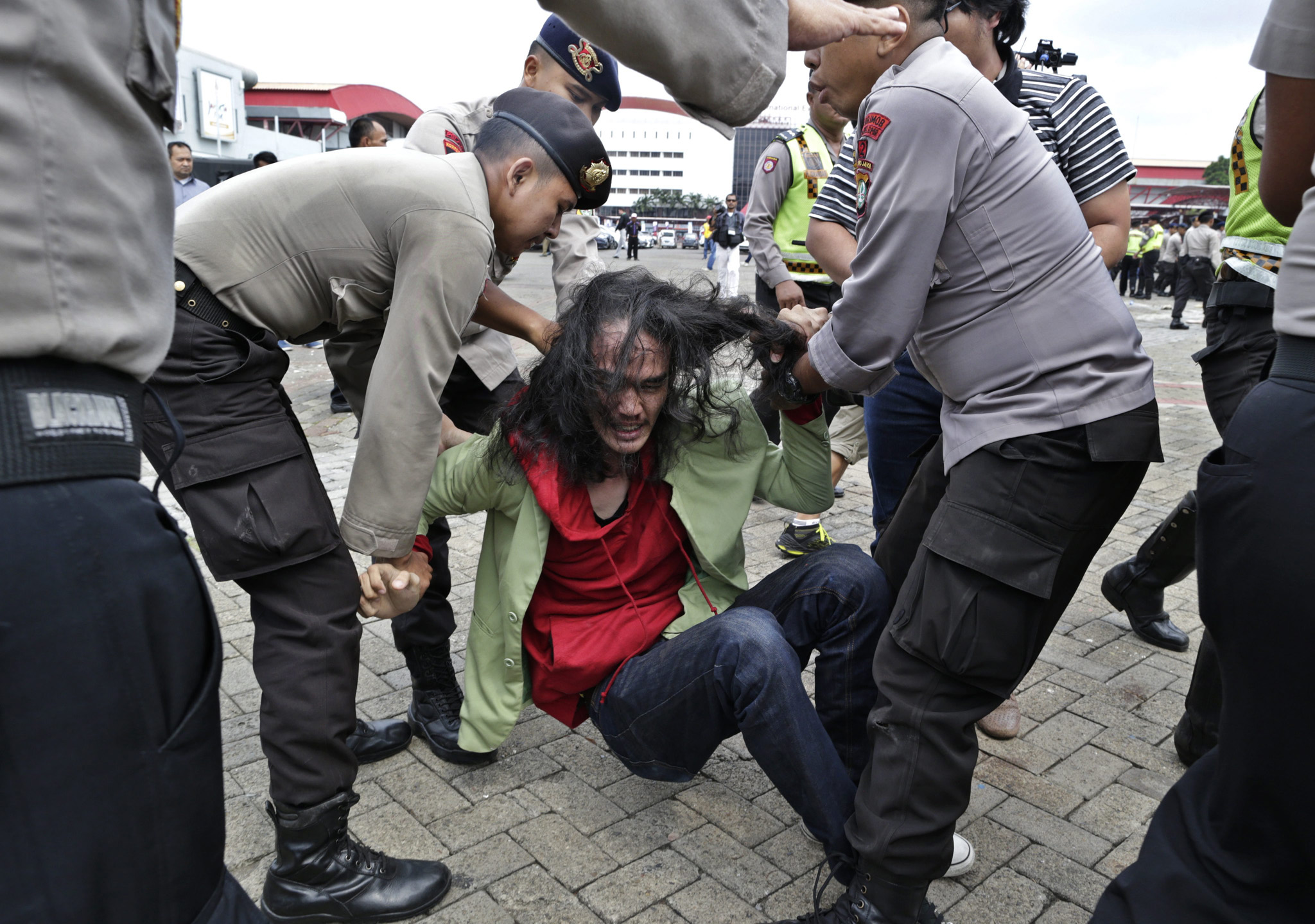 Protest against a tobacco exhibition in Jakarta...epa05279237 Indonesian students clash with police officers during an anti-tobacco protest outside the venue of the World Tobacco Process and Machinery Exhibition Asia 2016 in Jakarta, Indonesia, 27 April 2016. At least a hundred students staged a rally demanding the government to stop the exhibition, saying that it promotes smoking among youth and children. Indonesia ranks third in the world for the number of smokers after China and India, according to the World Health Organization.  EPA/MAST IRHAM
