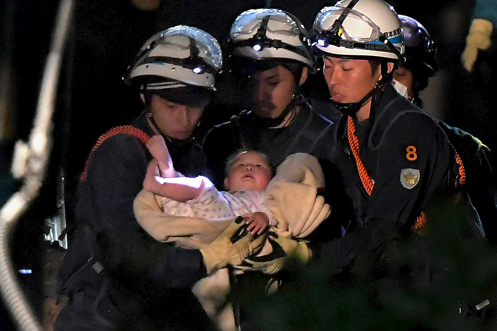 Baby is carried away by rescue workers after being rescued from her collapsed home caused by an earthquake in Mashiki town, Kumamoto prefecture, Japan...An eight-month-old baby is carried away by rescue workers after being rescued from her collapsed home caused by an earthquake in Mashiki town, Kumamoto prefecture, southern Japan, in this photo taken by Mainichi Shimbun April 15, 2016 early morning. Mandatory credit REUTERS/Daisuke Wada/Mainichi Shimbun via Reuters  ATTENTION EDITORS - THIS IMAGE WAS PROVIDED BY A THIRD PARTY. IT IS DISTRIBUTED EXACTLY AS RECEIVED BY REUTERS, AS A SERVICE TO CLIENTS. FOR EDITORIAL USE ONLY. NOT FOR SALE FOR MARKETING OR ADVERTISING CAMPAIGNS. MANDATORY CREDIT. NO RESALES. NO ARCHIVE. JAPAN OUT. NO COMMERCIAL OR EDITORIAL SALES IN JAPAN.       TPX IMAGES OF THE DAY
