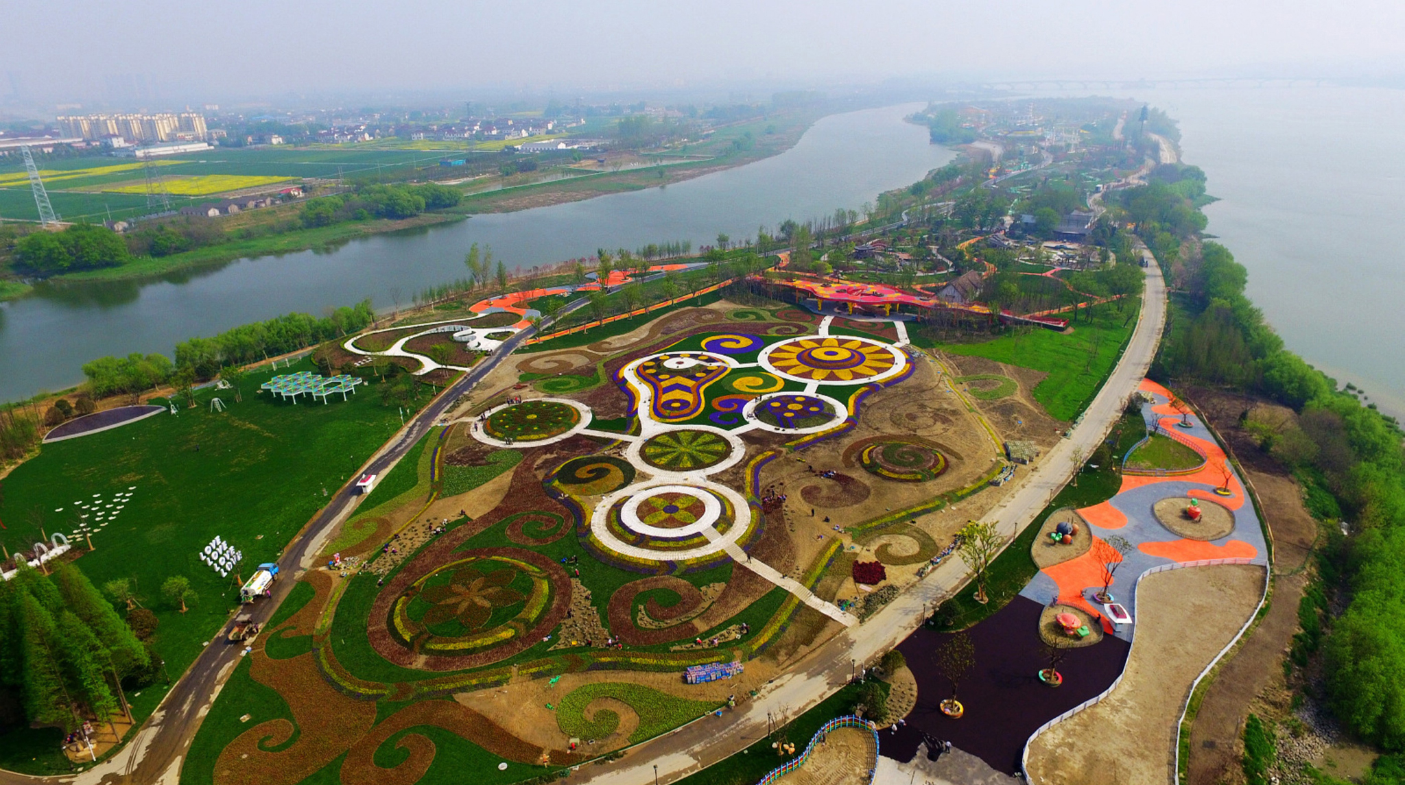 Marco Polo Flower World In Yangzhou...YANGZHOU, CHINA - APRIL 10:  (CHINA OUT) Aerial view of the flower fields in Marco Polo Flower World on April 10, 2016 in Yangzhou, Jiangsu Province of China. The Marco Polo Flower World included seven themed sessions with various kinds of flowers.  (Photo by VCG/VCG via Getty Images)