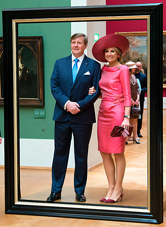 "Queen Maxima and King Willem-Alexander o...Queen Maxima and King Willem-Alexander of the Netherlands pose in a giant picture frame as they tour through the ""Hollaender-Saal"" (Dutchmen Hall) of the Alte Pinakothek museum in Munich, southern Germany, on April 13, 2016. The Dutch Royal couple is on a two-day official visit in the southern German federal state of Bavaria.  / AFP PHOTO / POOL / Sven Hoppe / ALTERNATIVE CROP SVEN HOPPE/AFP/Getty Images"