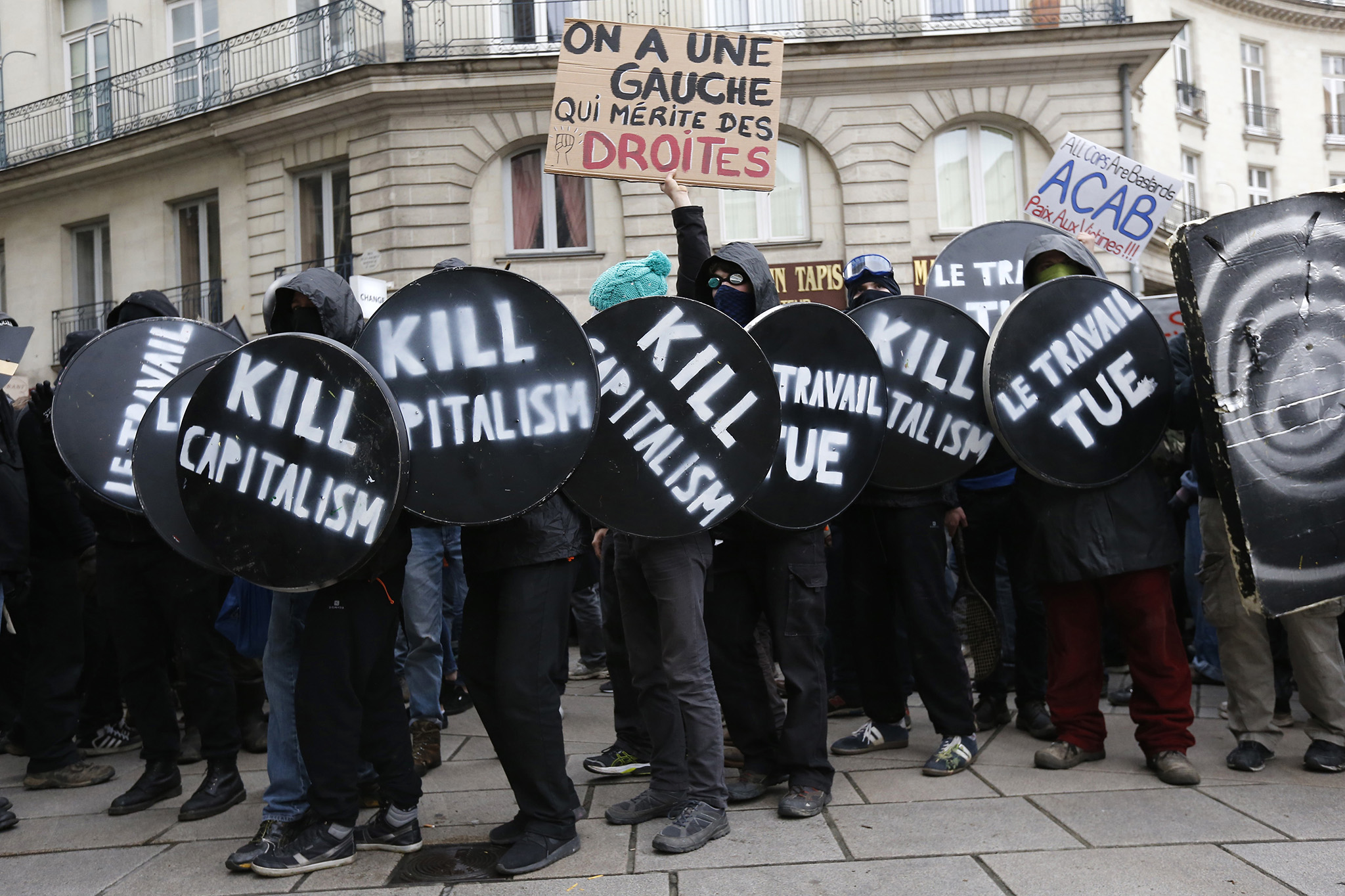 "French high school and university students attend a demonstration against the French labour law proposal in Nantes, France, as part of a nationwide labor reform protests and strikes. The slogan reads "" We have a leftist party who deserves to be punched""."