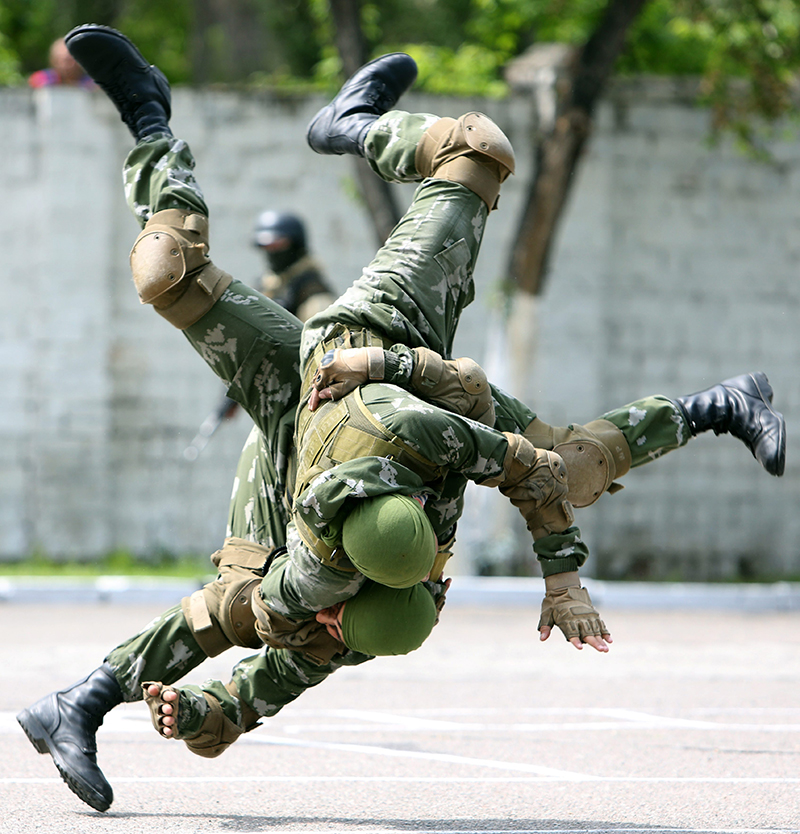 Kyrgyz military personnel show their skills during an exercises at a military base, 10 km outside Bishkek, Kyrgyzstan