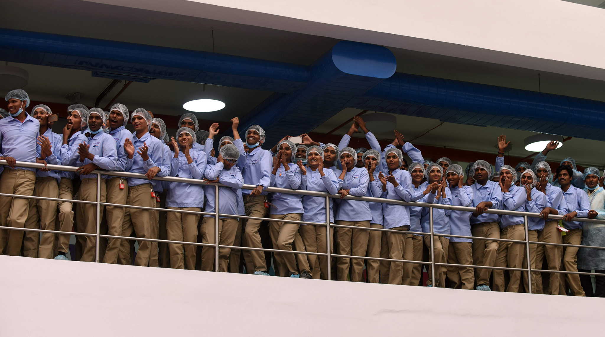 Indian workers cheer during the opening of the Mondelez International facility in Sri City in the Indian state of Andhra Pradesh on 25 April, 2016. The facility will produce approximately 60,000 tons of Cadbury Dairy Milk chocolate annually.