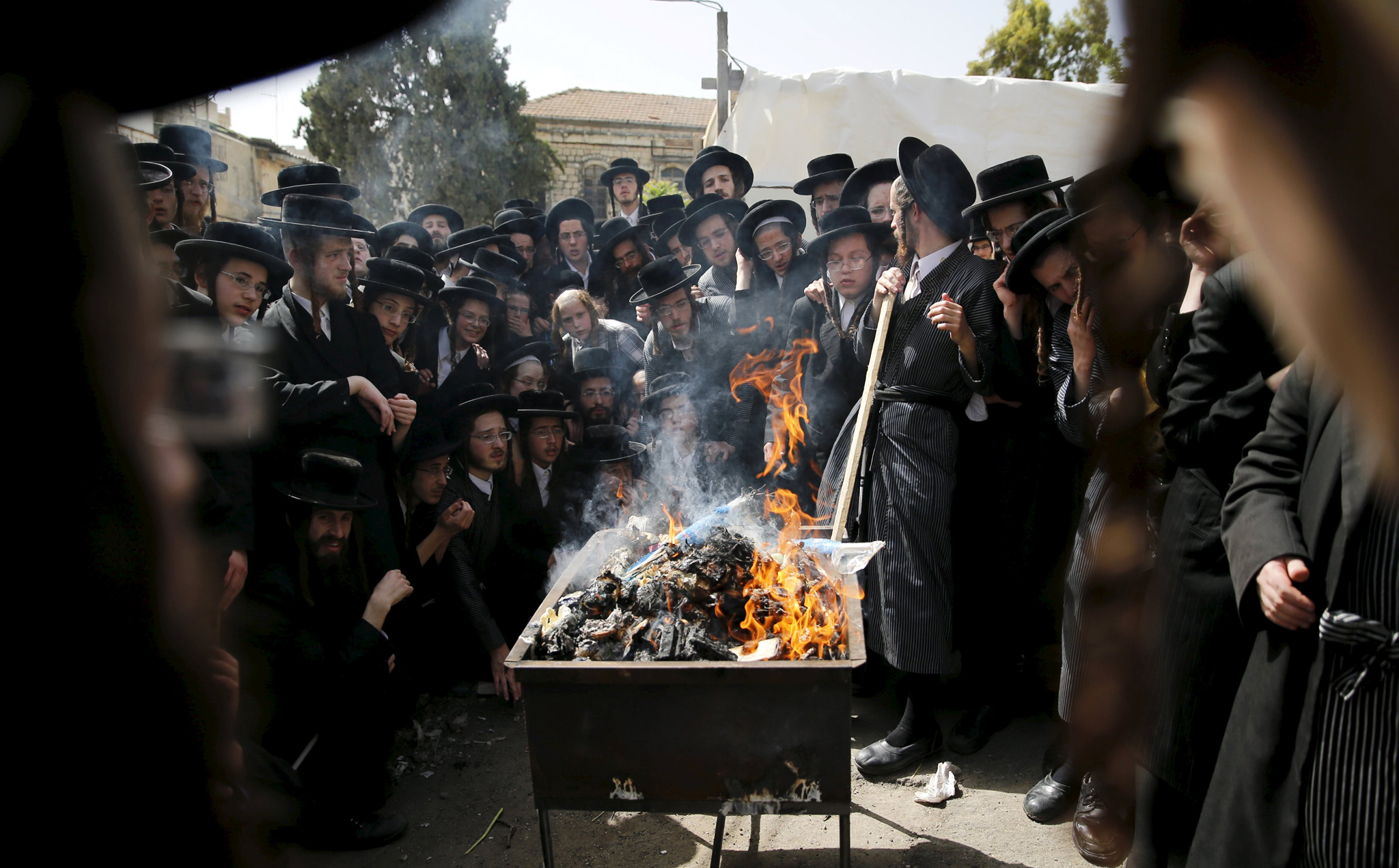 Ultra-Orthodox Jews burn leaven in the Mea Shearim neighbourhood of Jerusalem, ahead of the Jewish holiday of Passover...Ultra-Orthodox Jews burn leaven in the Mea Shearim neighbourhood of Jerusalem, ahead of the Jewish holiday of Passover, April 22, 2016. REUTERS/Ammar Awad