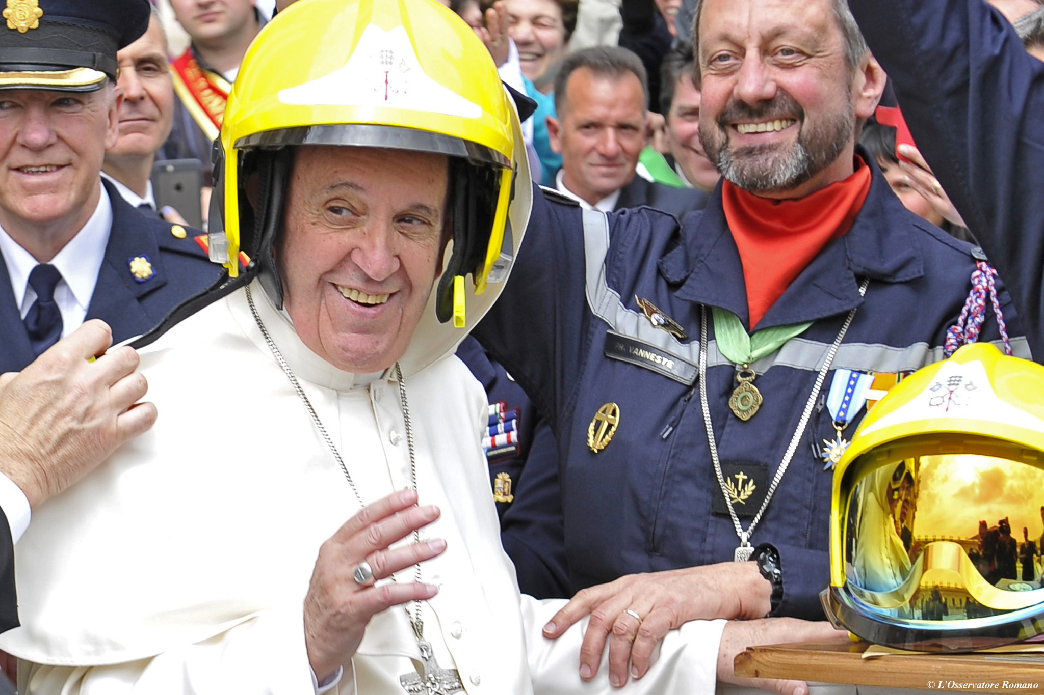 "This handout picture released by the Vat...This handout picture released by the Vatican press office shows Pope Francis wearing an elmet as he jokes with French firemen of Paris (Pompiers de Paris) at the end of his weekly general audience on April 13, 2016 at the Vatican. AFP PHOTO / OSSERVATORE ROMANO/HO  RESTRICTED TO EDITORIAL USE - MANDATORY CREDIT ""AFP PHOTO / OSSERVATORE ROMANO"" - NO MARKETING NO ADVERTISING CAMPAIGNS - DISTRIBUTED AS A SERVICE TO CLIENTSHO/AFP/Getty Images"