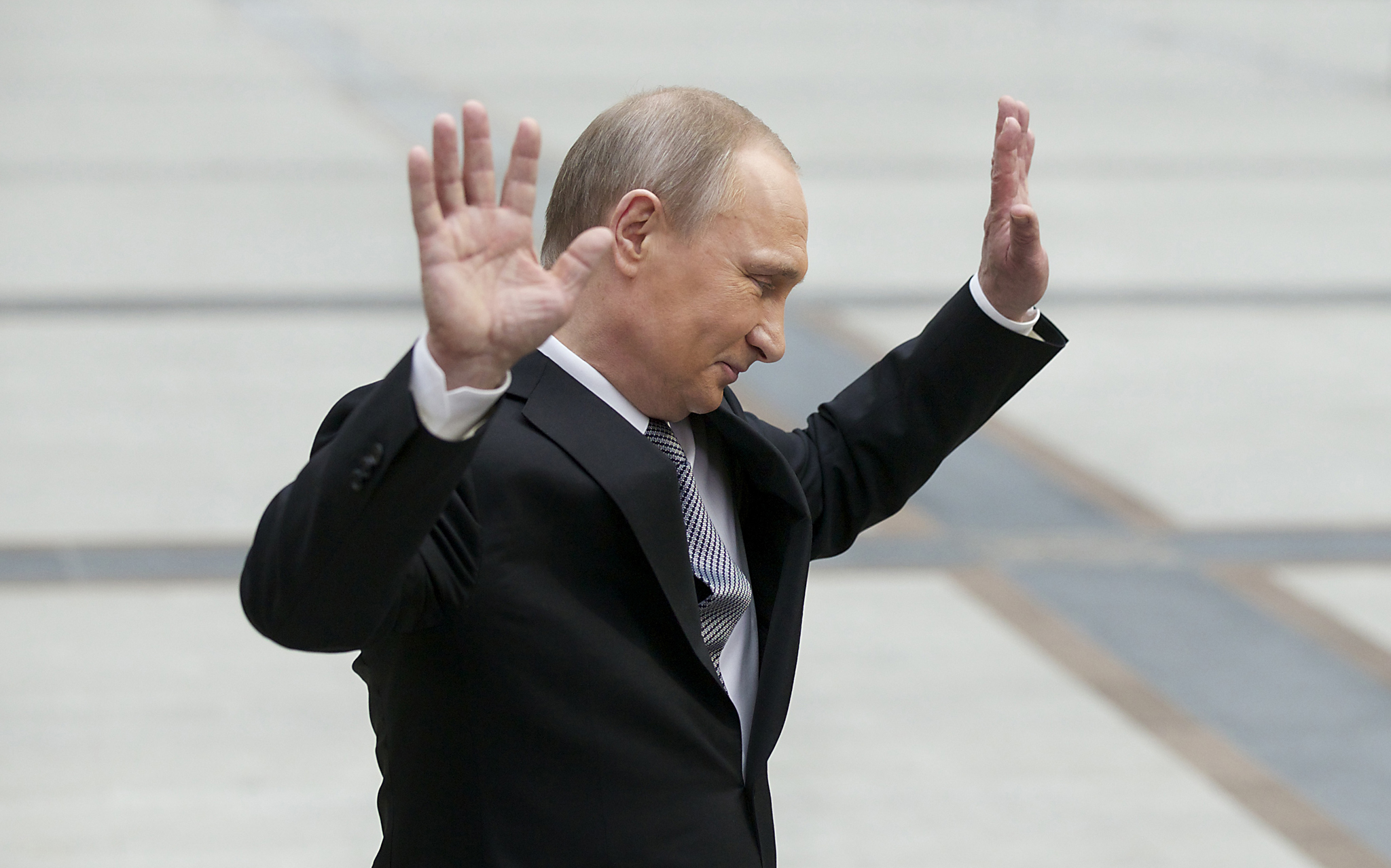 "Vladimir Putin...Russian President Vladimir Putin gestures after speaking to the media after his marathon call-in TV show in Moscow, Russia, on Thursday, April 14, 2016. Russian President Vladimir Putin says the United States must abandon its ""imperial ambitions"" and treat Russia as an equal partner. (AP Photo/Alexander Zemlianichenko)"