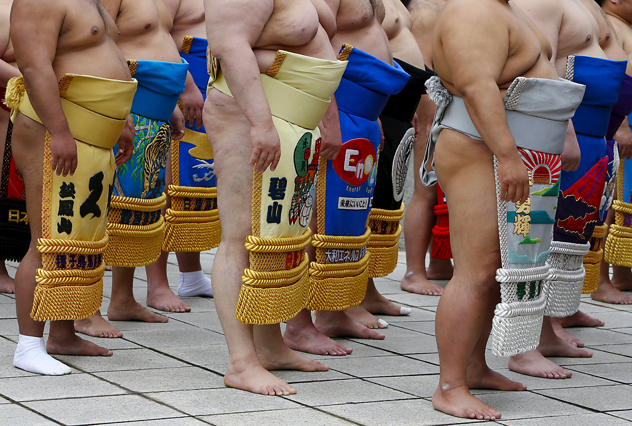 "Sumo wrestlers line up as they pray before the start of the annual 'Honozumo' ceremonial sumo tournament dedicated to the Yasukuni Shrine in Tokyo, Japan...Sumo wrestlers line up as they pray before the start of the annual 'Honozumo' ceremonial sumo tournament dedicated to the Yasukuni Shrine in Tokyo, Japan, April 18, 2016.  REUTERS/Yuya Shino SEARCH ""SHINO SUMO"" TO SEE ALL THE PICTURES."