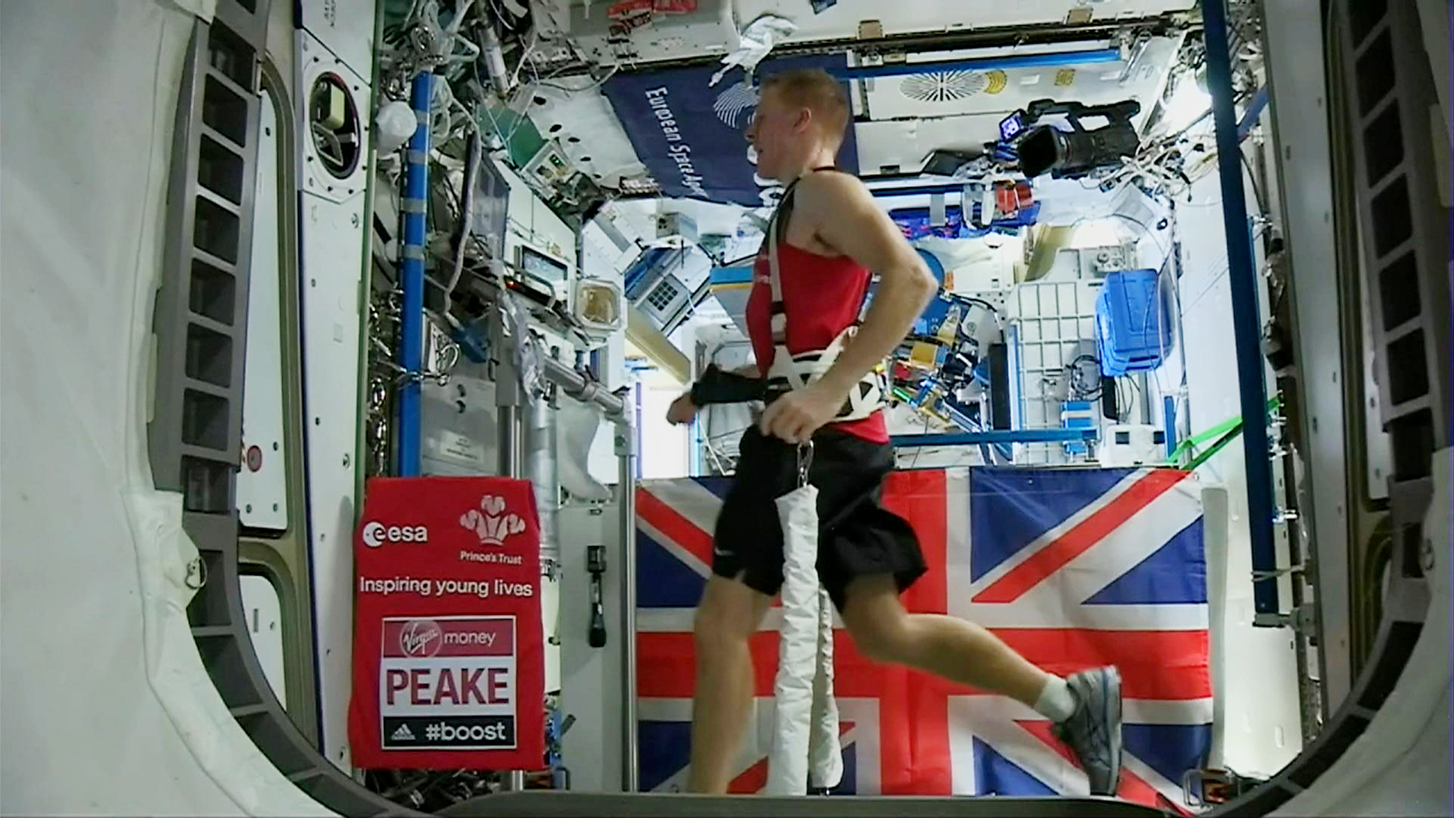 British astronaut Tim Peake in action running the London marathon while strapped to a treadmill at the International Space Station on Sunday April 24, 2016. While the official 2016 London Marathon was being run in London, Peake ran 26.2 miles on a treadmill in three hours 35 minutes 21 seconds, while aboard the apace station in orbit 250km above the Earth.(EUROPEAN SPACE AGENCY (ESA) via AP) TV OUT