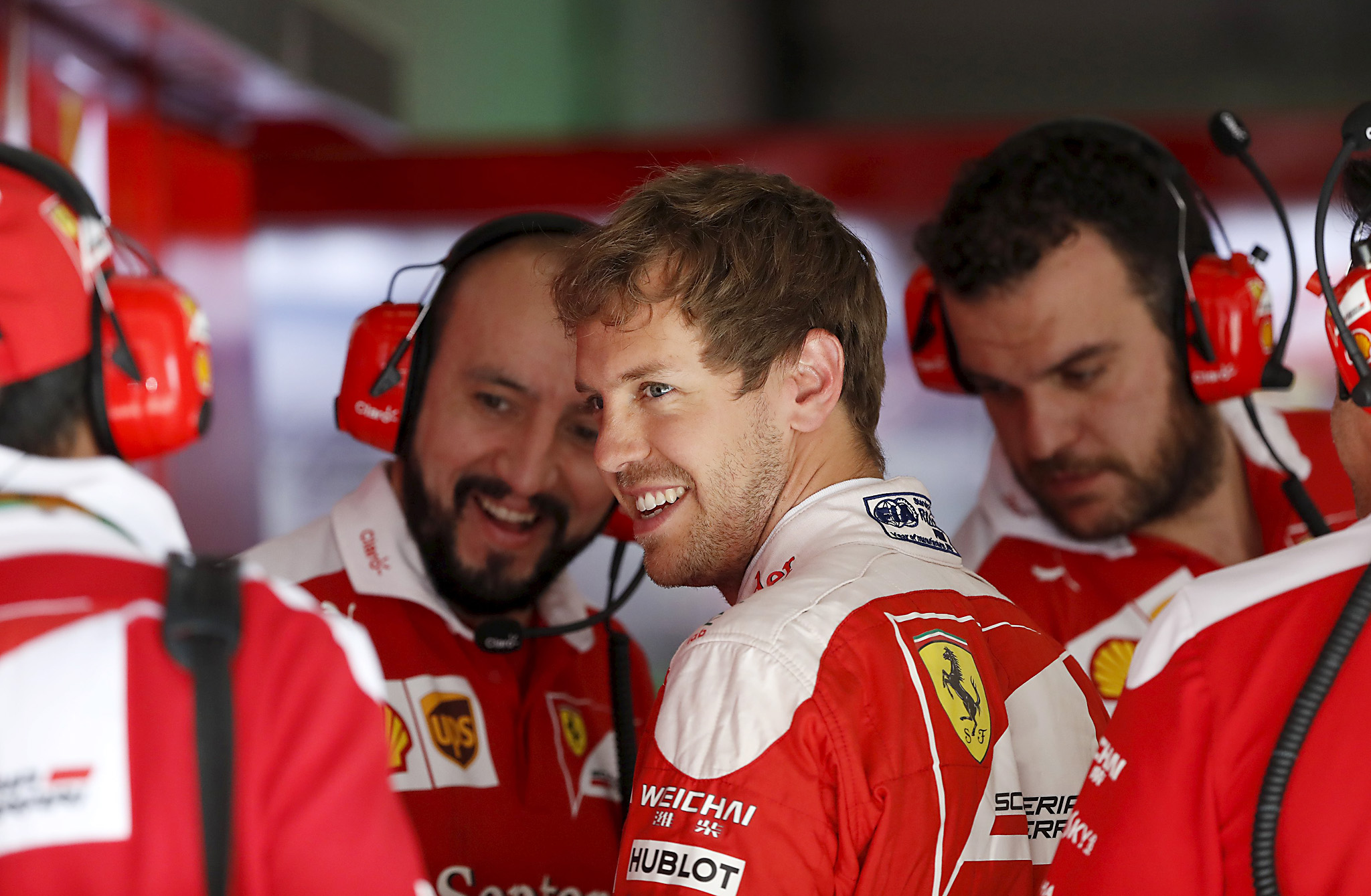 Formula One - Chinese Grand Prix - Shanghai...Formula One - Chinese Grand Prix - Shanghai, China - 4/15/16 - Ferrari Formula One driver Sebastian Vettel of Germany arrives at his garage during the first practice session.  REUTERS/Aly Song
