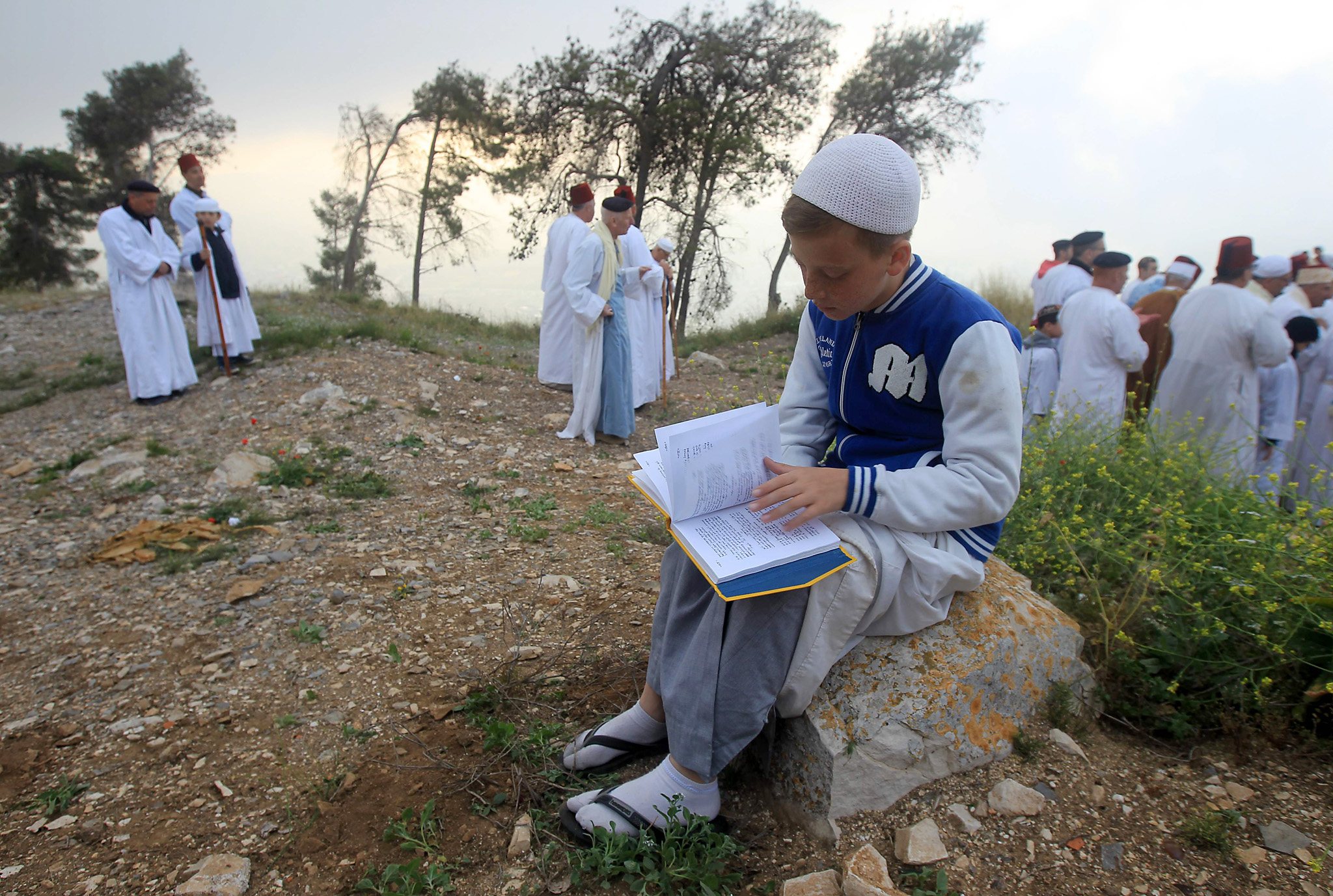 Members of the ancient Samaritan community attend the Passover pilgrimage to the religion's holiest site on the top Mount Gerizim near the West Bank town of Nablus, early Wednesday, April 27, 2016. Samaritans descended from the ancient Israelite tribes of Menashe and Efraim but broke away from mainstream Judaism 2,800 years ago. Today, the remaining 700 Samaritans live in the Palestinian city of Nablus in the West Bank and the Israeli seaside town of Holon, south of Tel Aviv. (AP Photo/Majdi Mohammed)