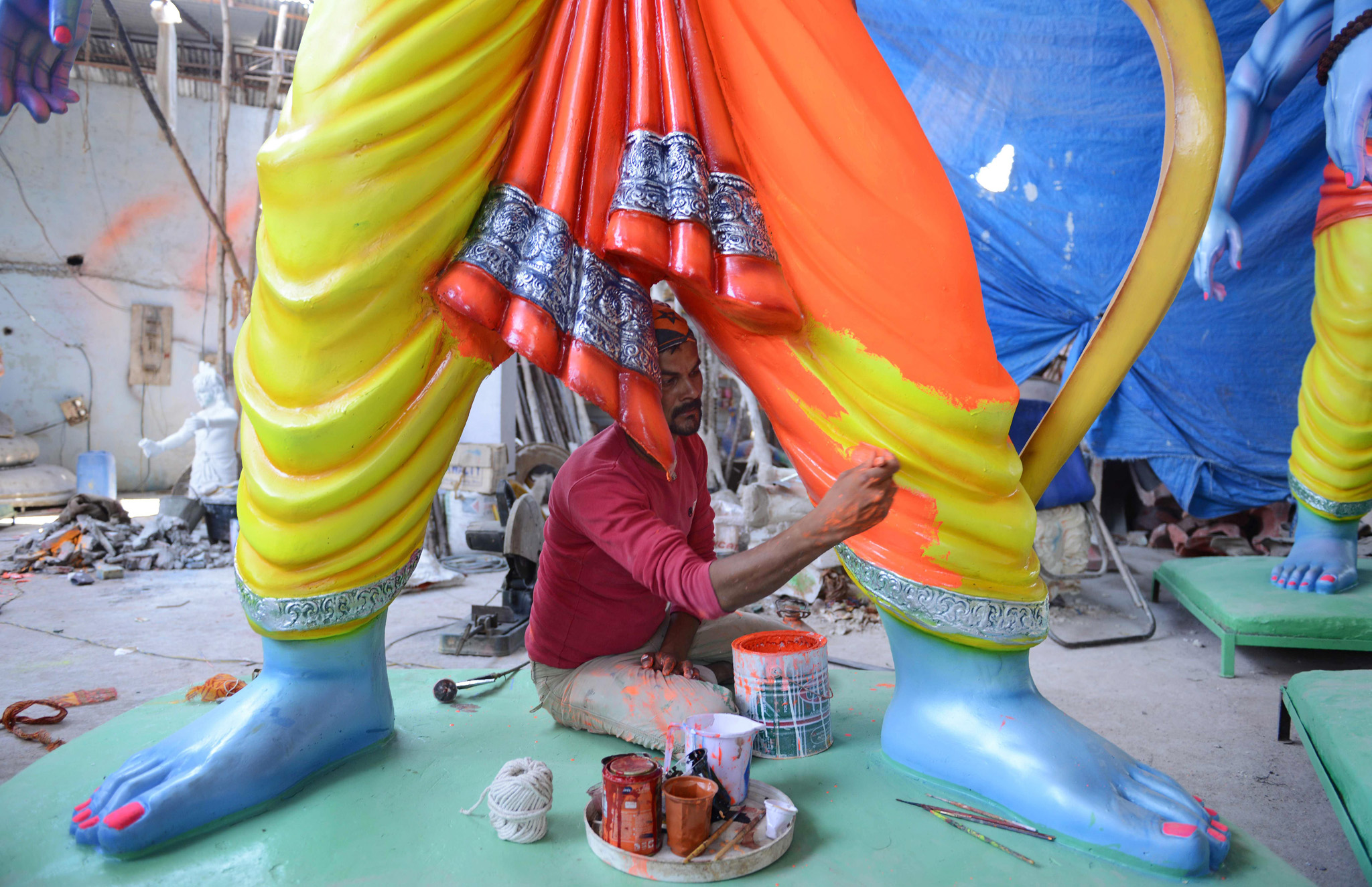 An Indian artist puts the final touches to statues of the Hindu God Lord Ram ahead of the Sri Rama Navami Festival at a workshop in Hyderabad