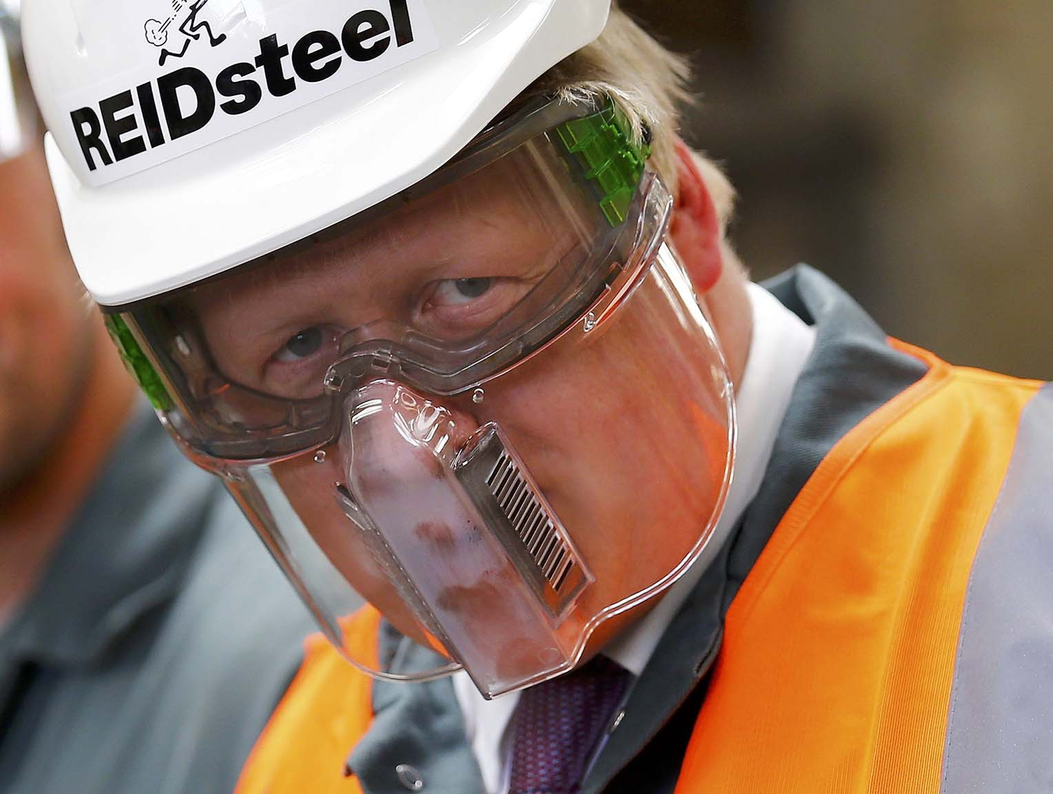 Former mayor of London and Vote Leave campaigner Boris Johnson wears protective equipment as he visits Reid Steel during a campaign stop in Christchurch