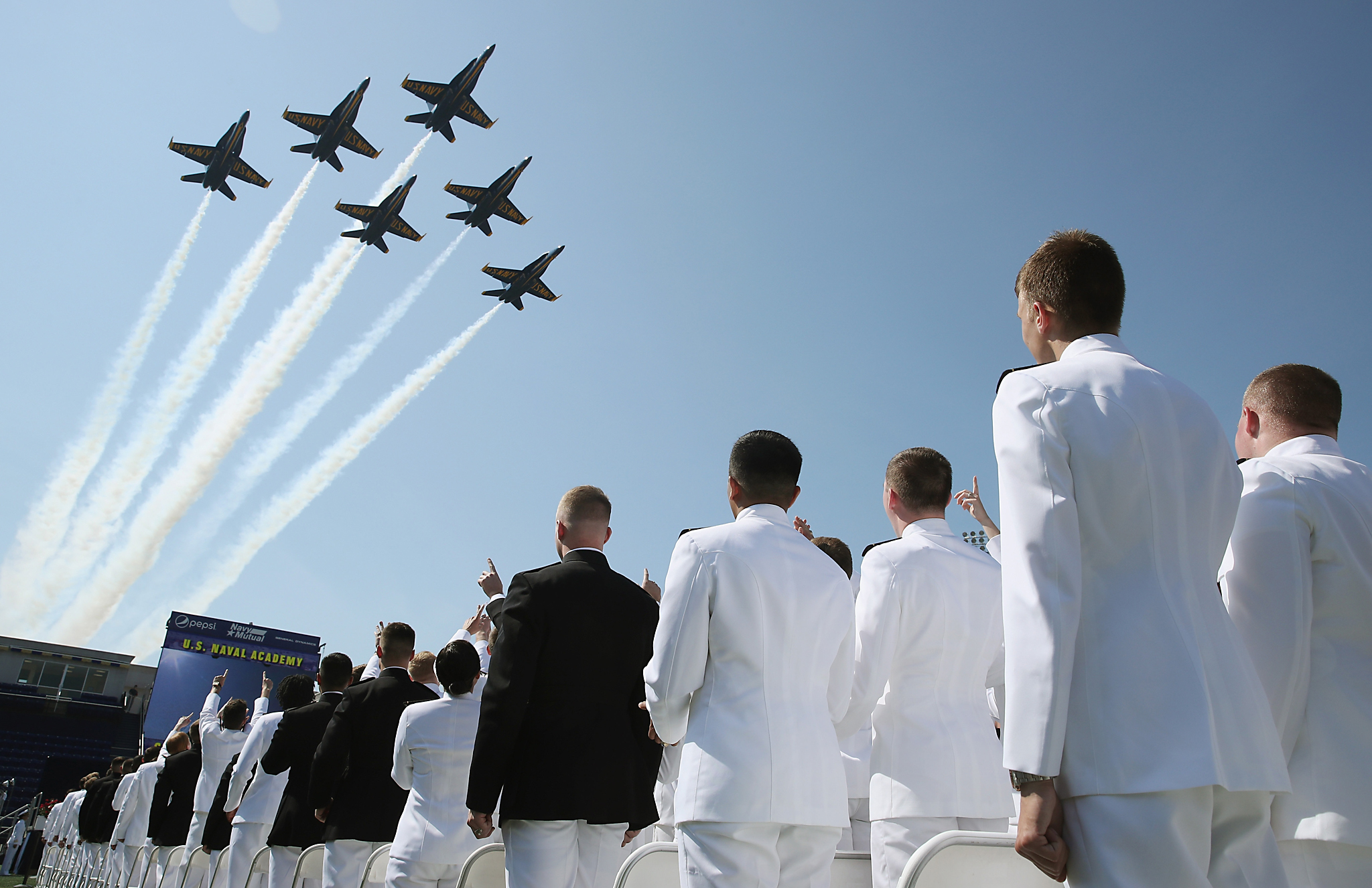 ANNAPOLIS, MD - MAY 27: The U.S. Navy Blue Angels fly over graduation ceremonies at the U.S. Naval Academy May 27, 2016 in Annapolis, Maryland.  U.S. Secretary of Defense Ashton Carter is the commencement speaker for this year's graduating class.  (Photo by Mark Wilson/Getty Images)