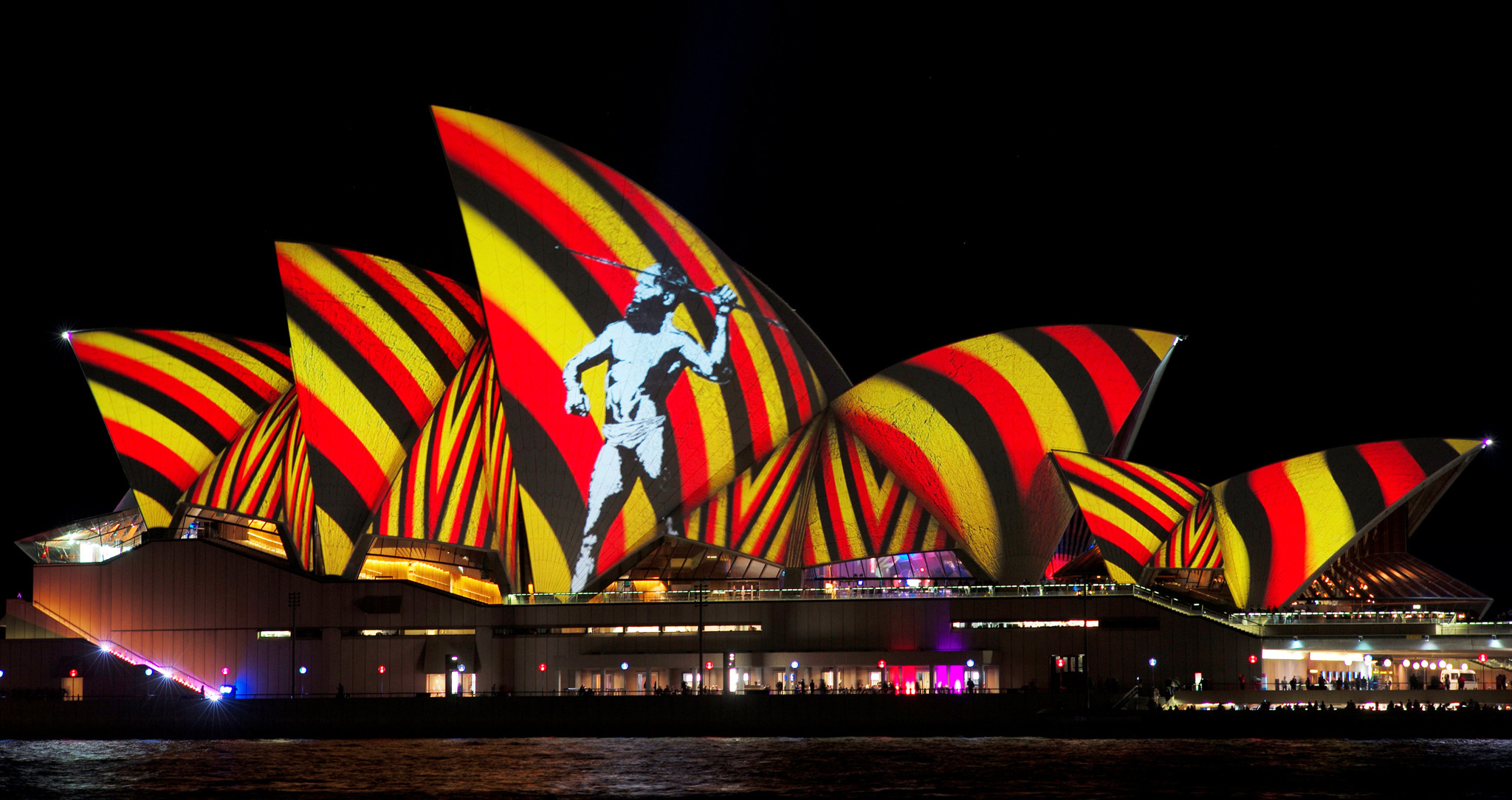 An image of an indigenous Australian man is projected onto the sails of the Sydney Opera House during the opening night of the annual Vivid Sydney light festival in Sydney, Australia, May 27, 2016. REUTERS/Jason Reed      TPX IMAGES OF THE DAY
