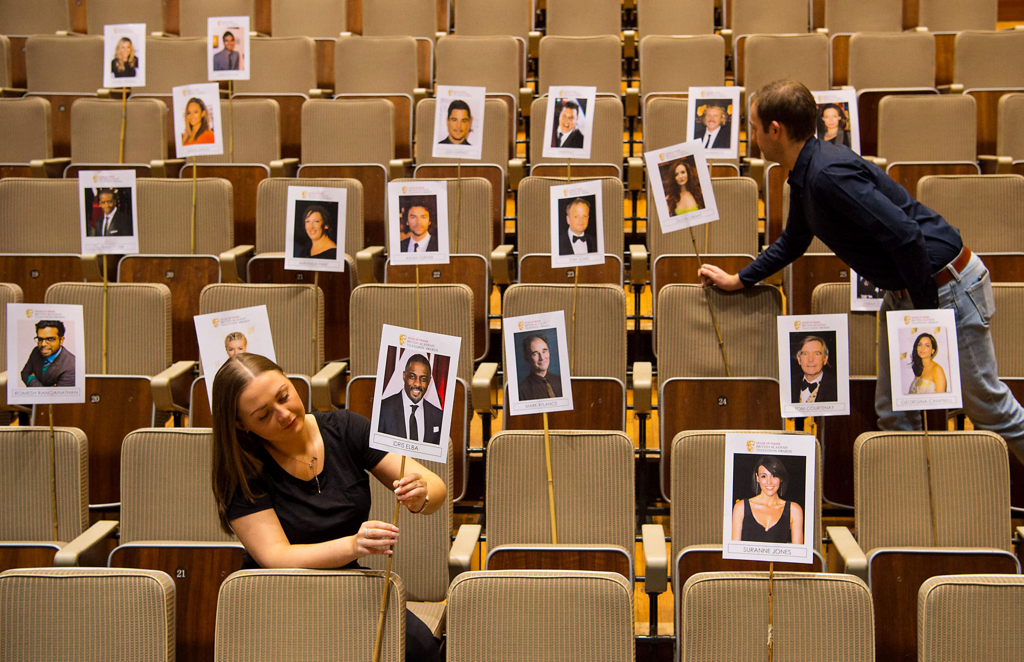 House of Fraser BAFTA TV Awards preparations - London...Members of BAFTA staff adjust heads on sticks showing the seating plan for nominees and guests at the House of Fraser BAFTA TV Awards, at the Royal Festival Hall, London. PRESS ASSOCIATION Photo. Picture date: Thursday May 5, 2016.