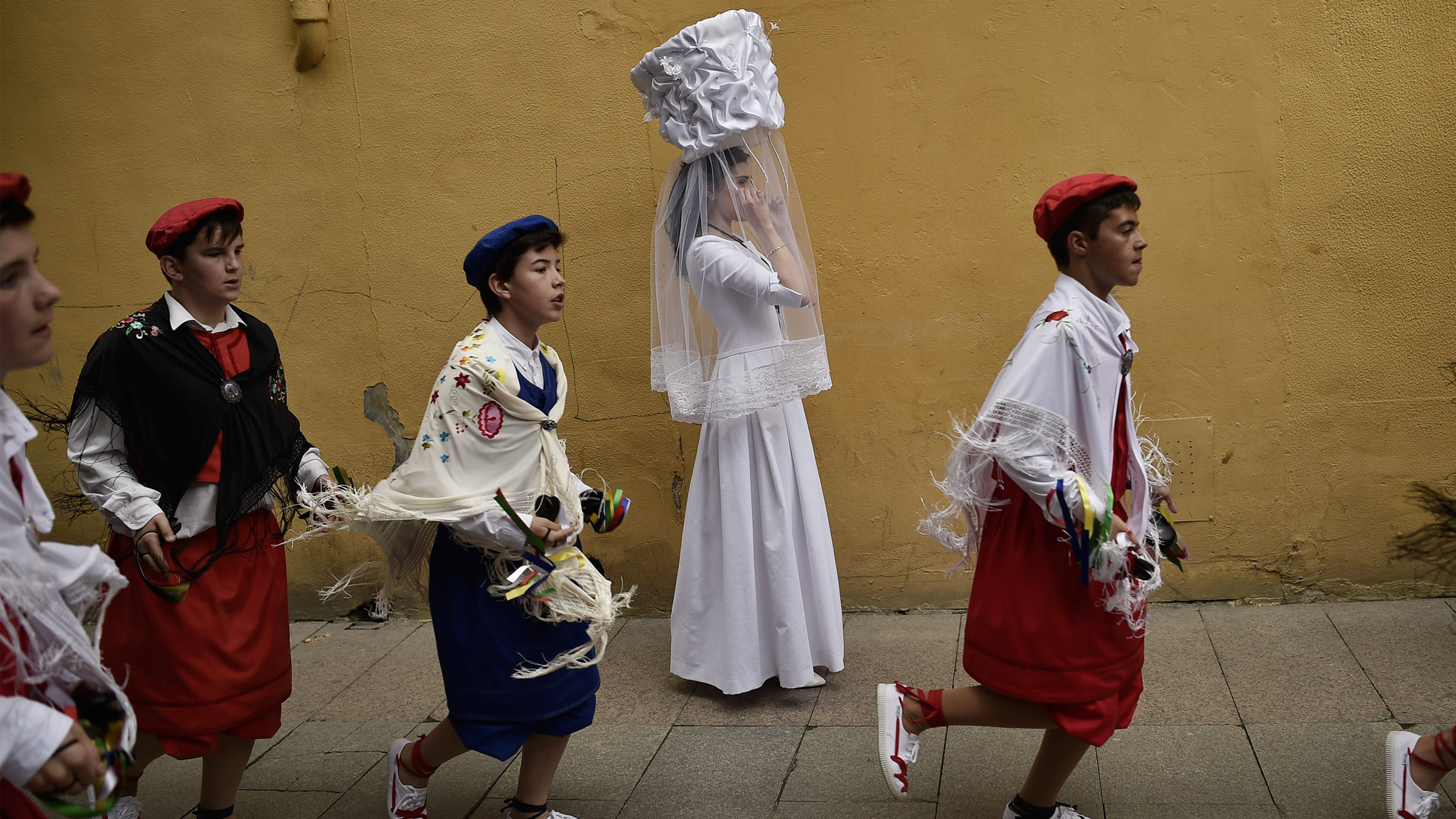 A participant in the ''Bread Procession of the Saint'' takes part in a ceremony in honor of Domingo de La Calzada Saint (1019-1109), in Santo Domingo de La Calzada, northern Spain, Wednesday, May 11, 2016. Every year during spring season, ''Las Doncellas'' (White Virgins), hold a basket on their head covered with white cloth while they walk along this old village in honor of the saint.